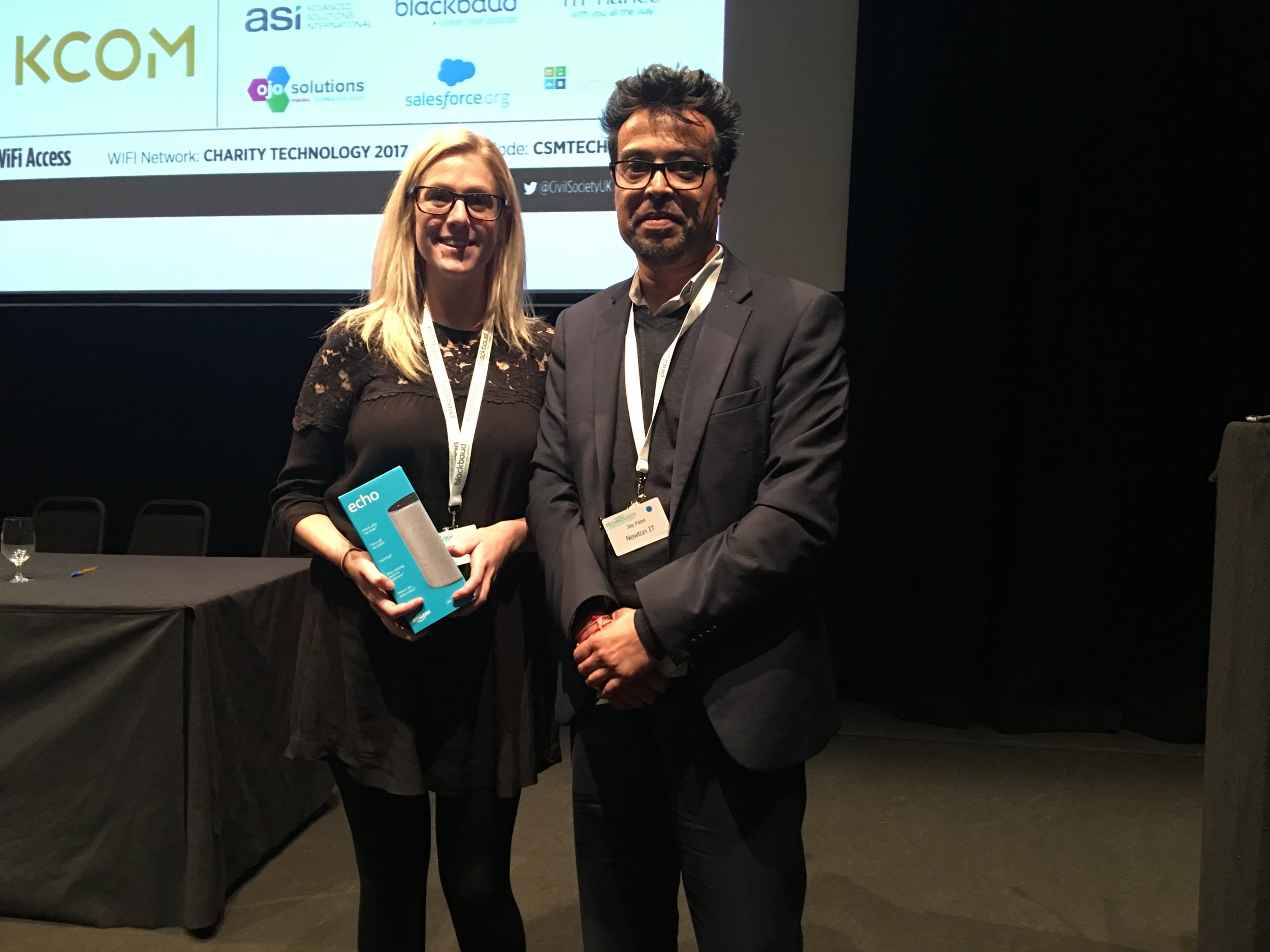 Claire Edwards - Winner of the Amazon Alexa Echo at the Charity Technology Conference 2017. Prize awarded by Jay Patel, Managing Director of Newton IT Solutions.