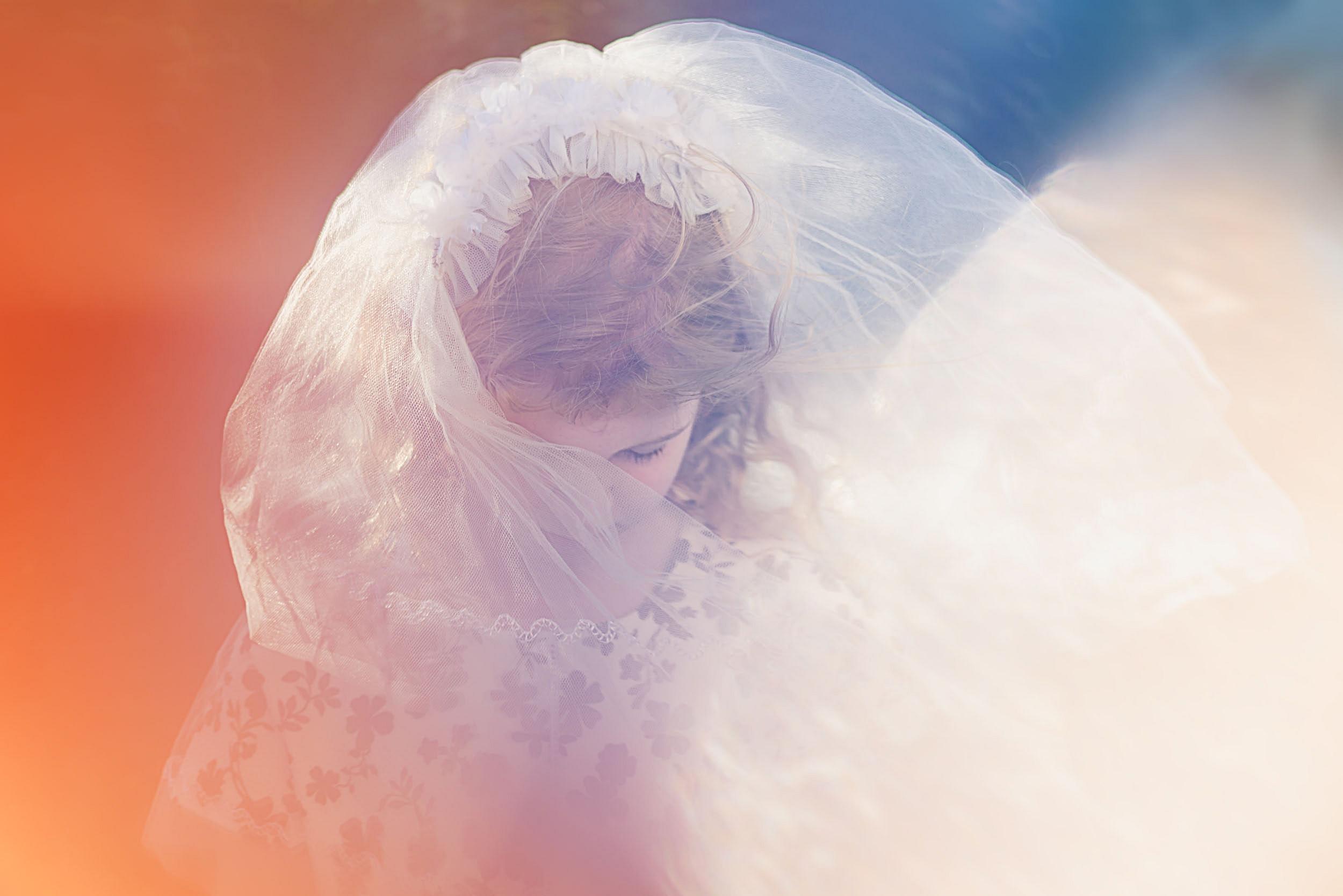 Katy Bindels Brisbane Portrait Photographer girl-in-communion-veil.jpg