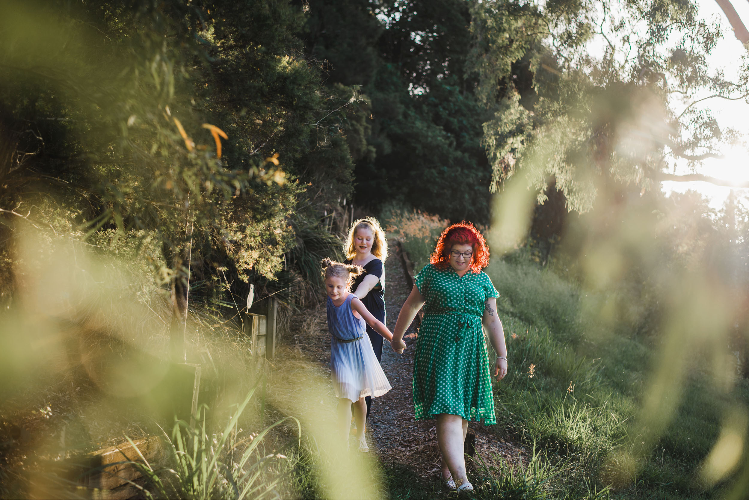 Katy Bindels Brisbane family Photographer walking-down-hill.jpg