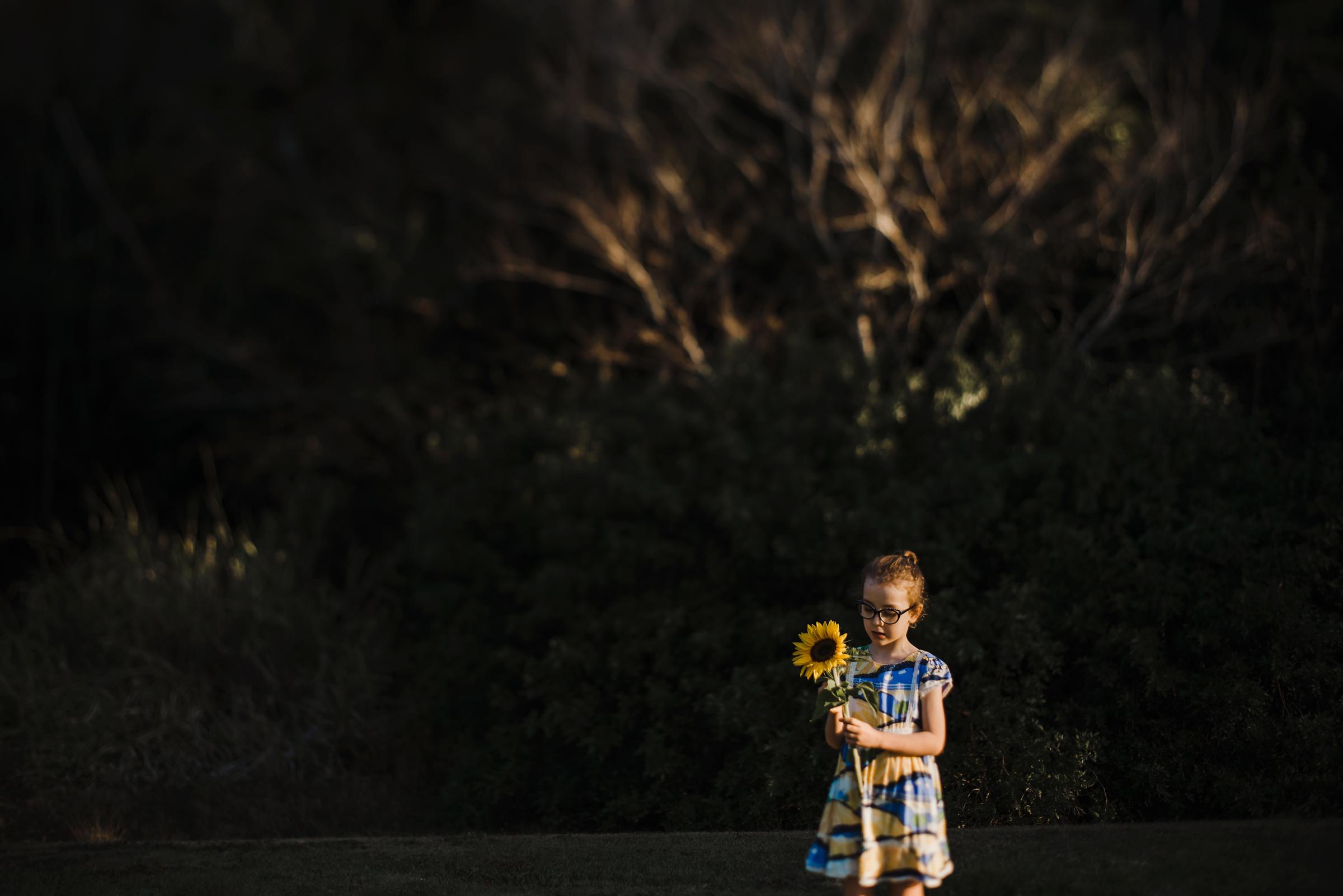 little_girl_big_sunflower.jpg