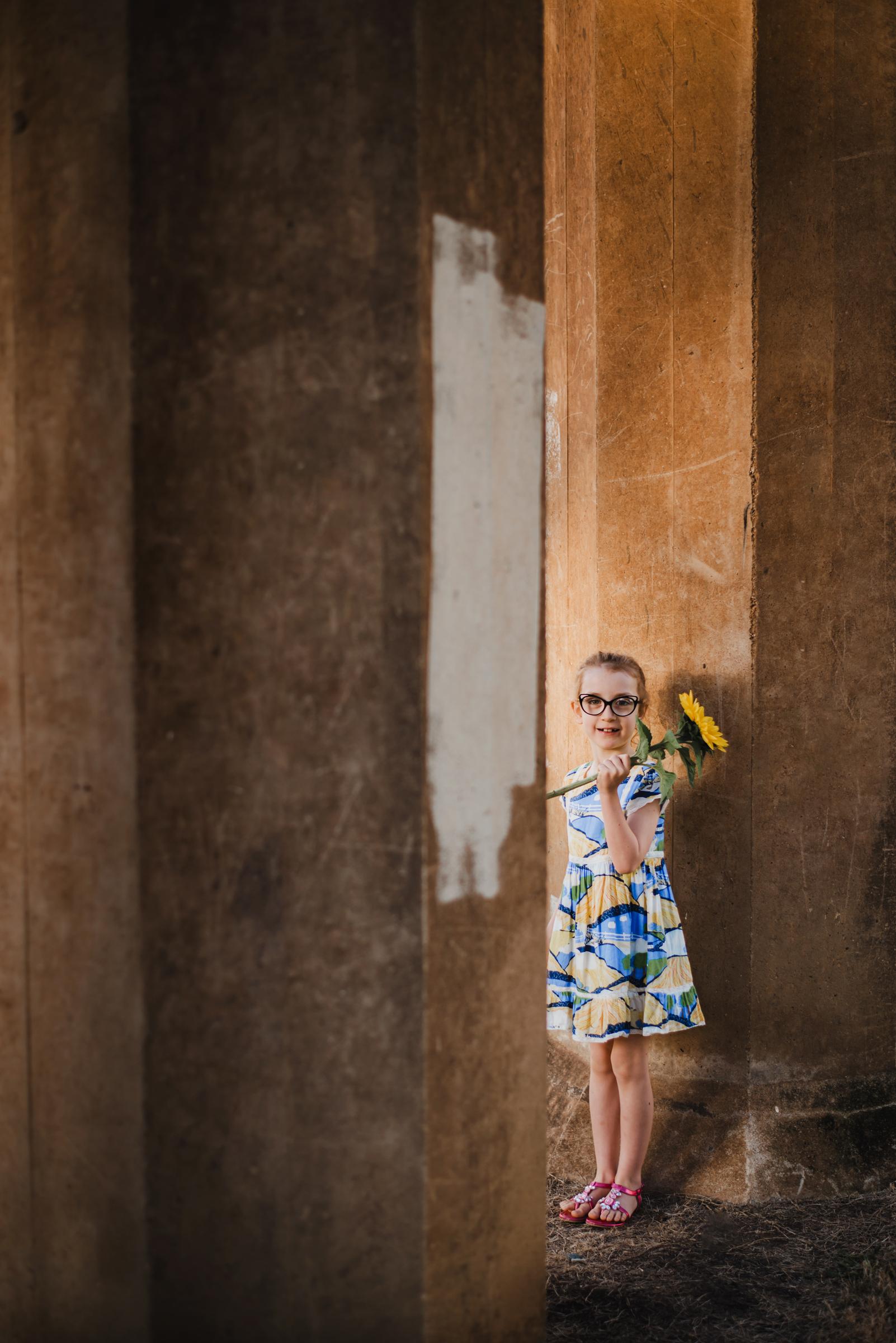 Brisbane_child_portrait_with_flower.jpg