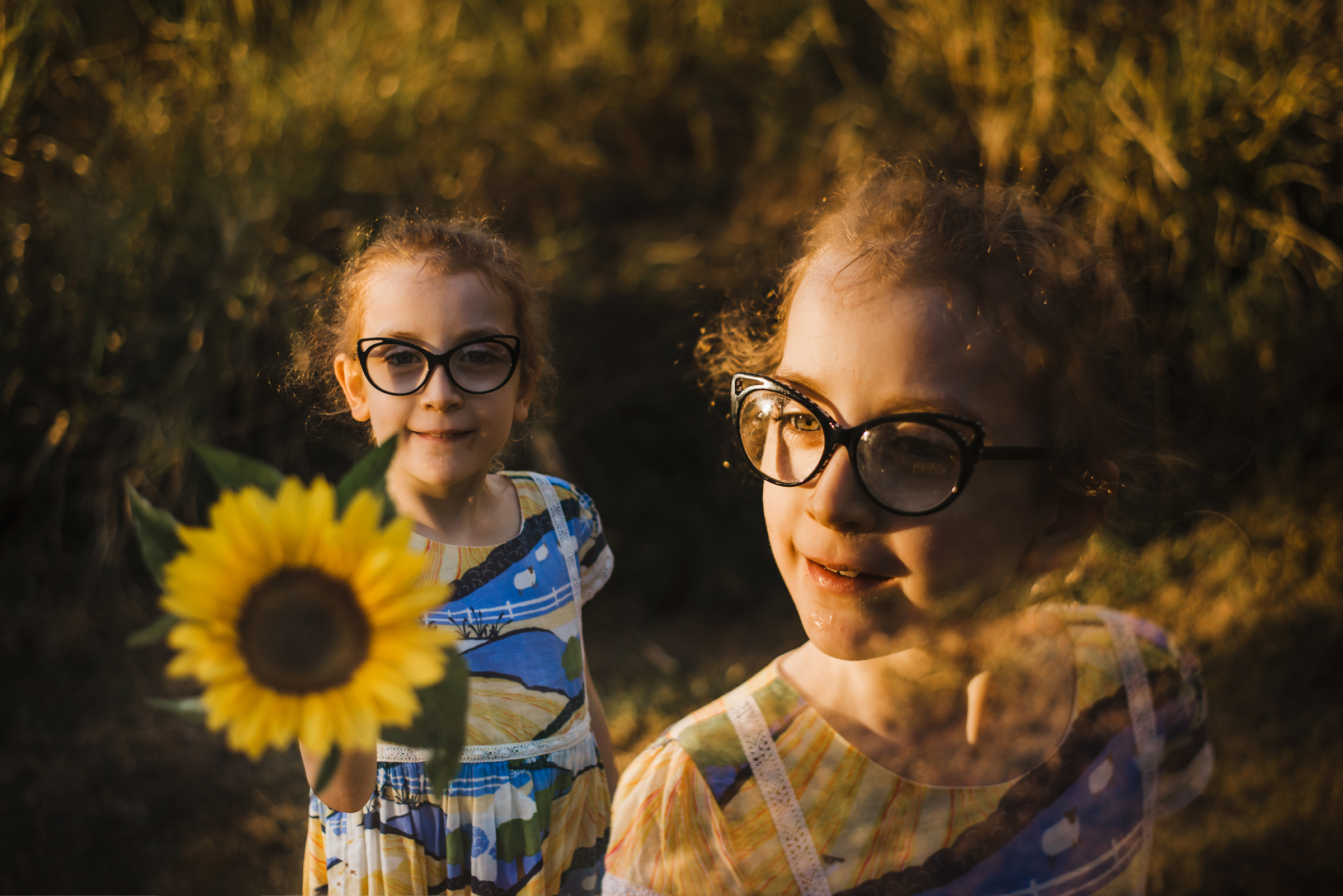 double_exposure_portrait_of_child_with_sunflower.jpg