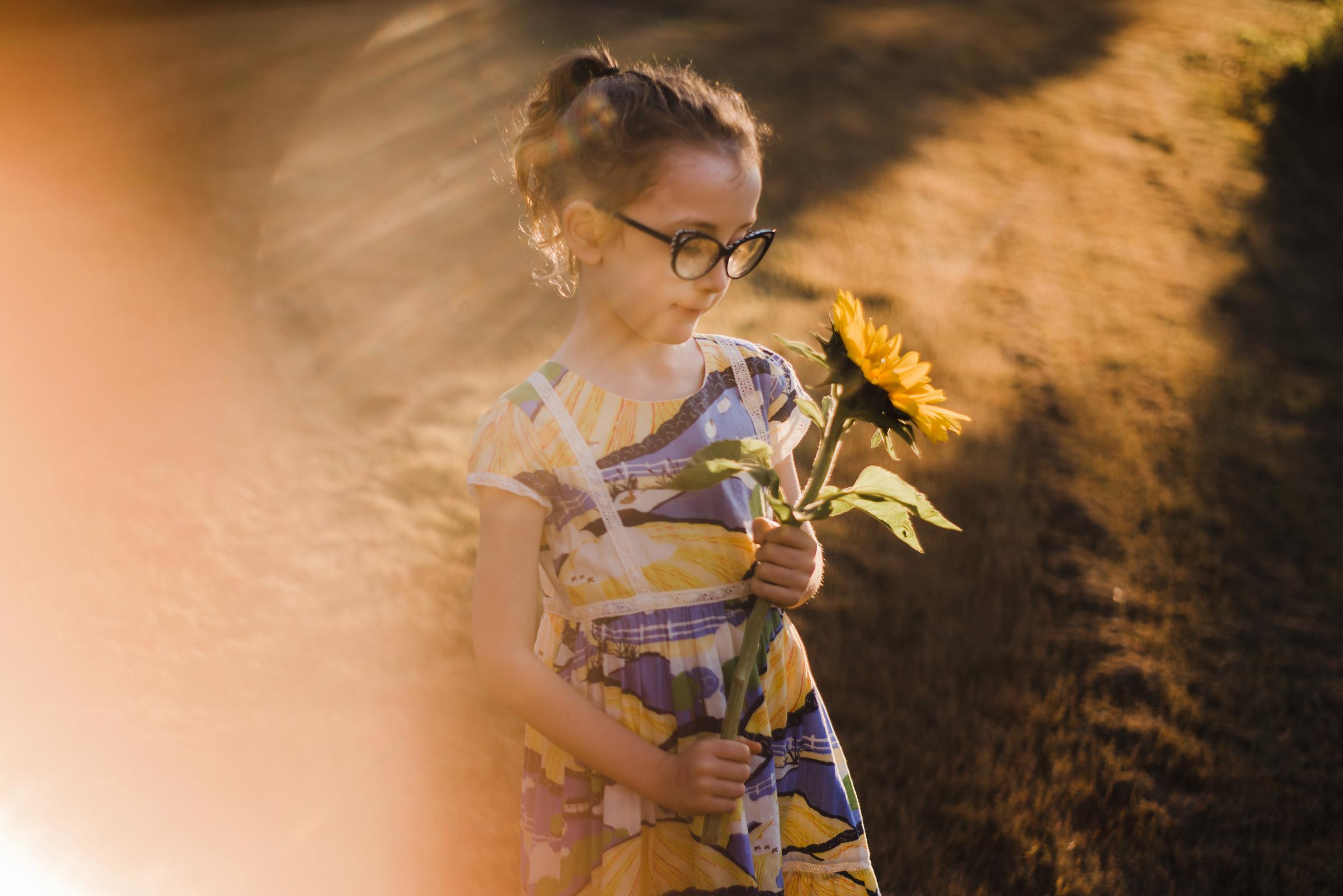 girl_admiring_sunflower.jpg