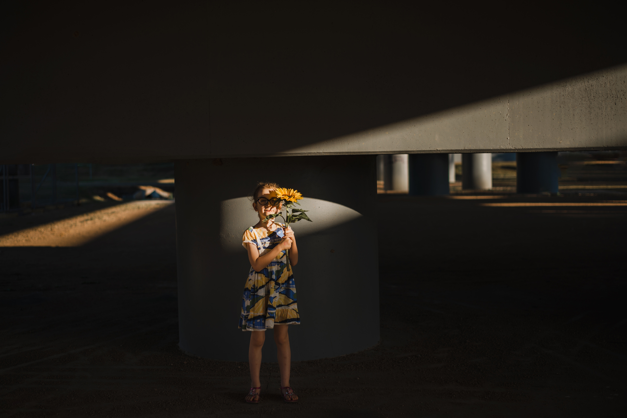 portrait_of_child_and_flower_in_shadows.jpg