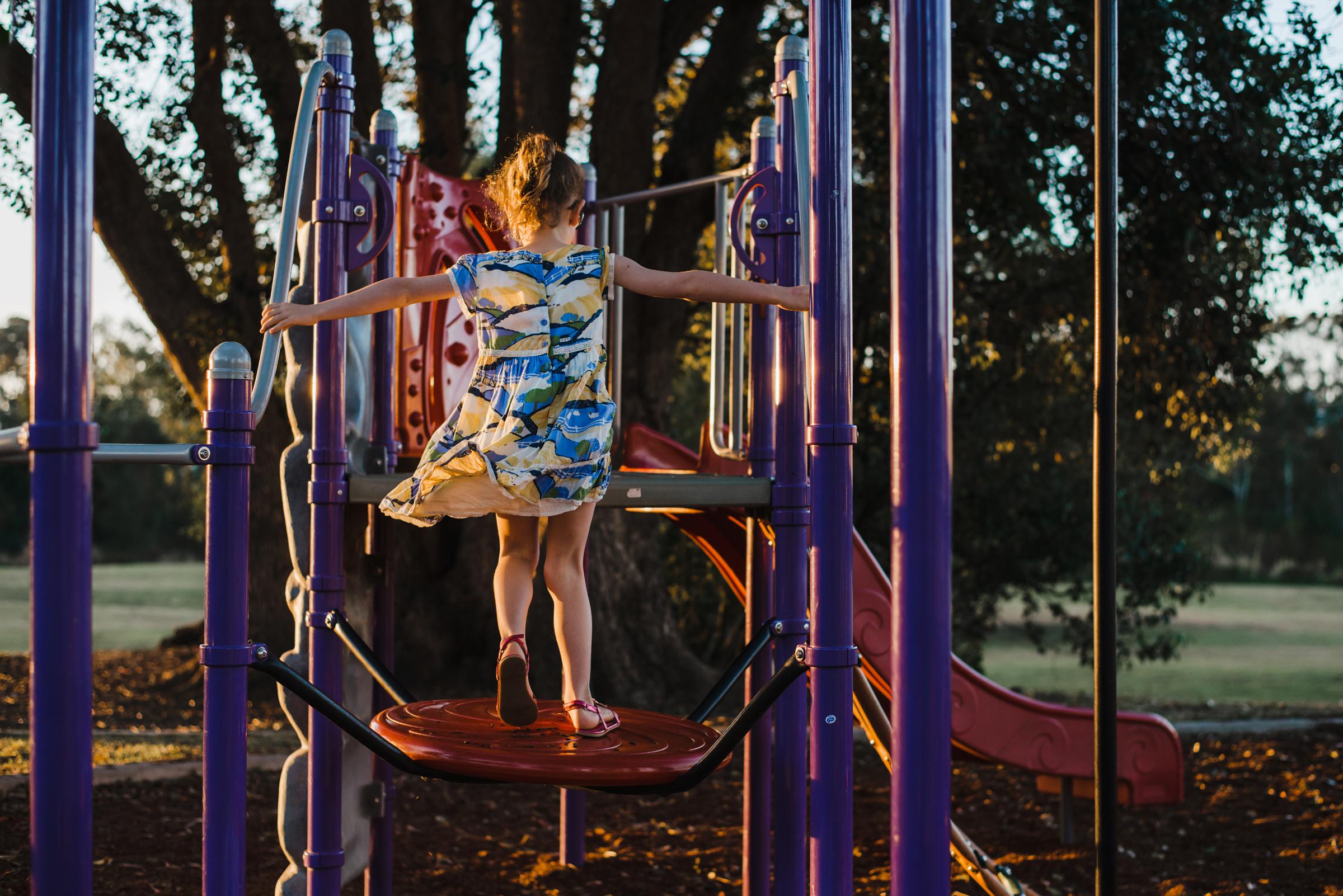 girl_on_play_equipment.jpg