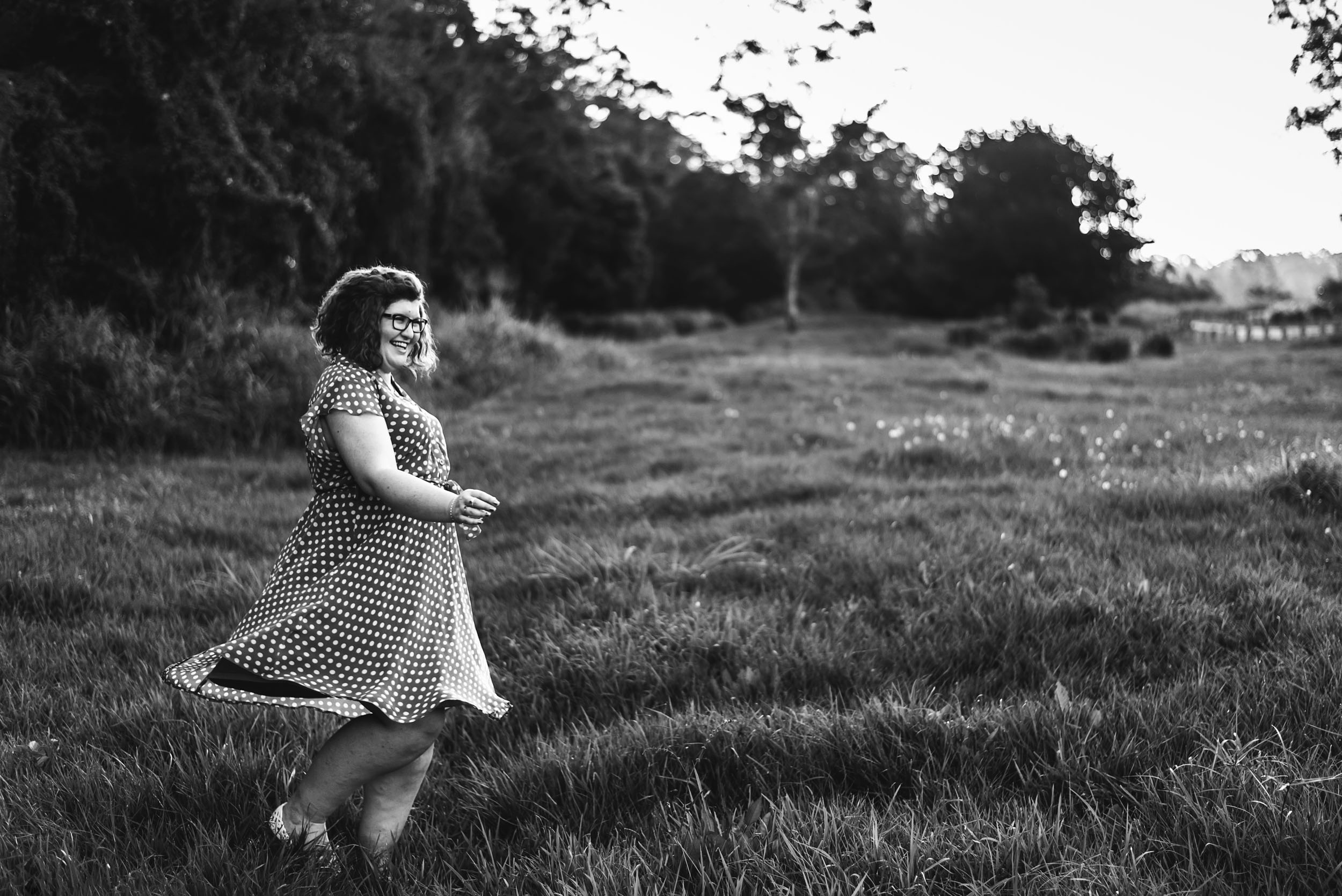 Happy woman twirling during photography session