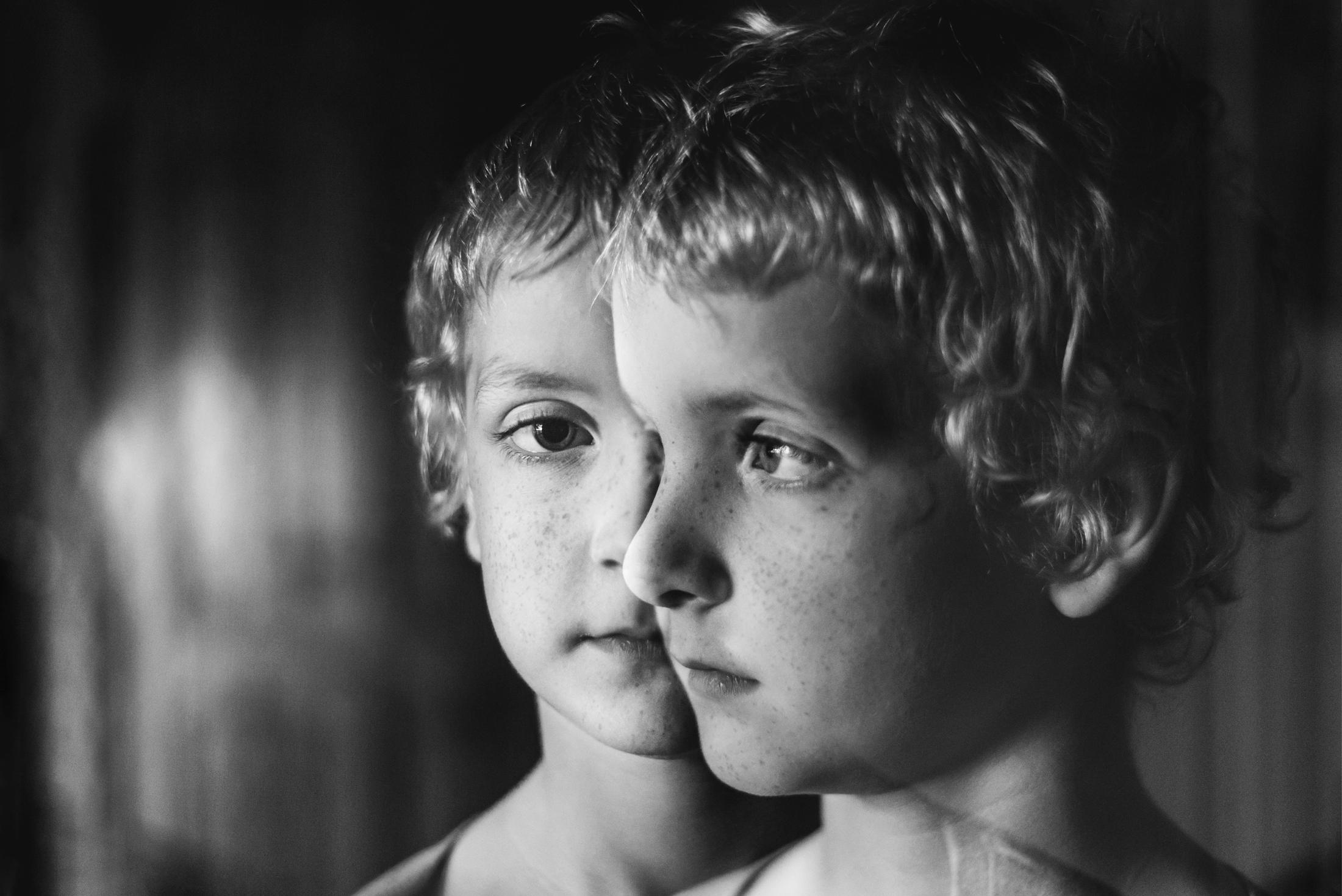 Double exposure portrait of boy
