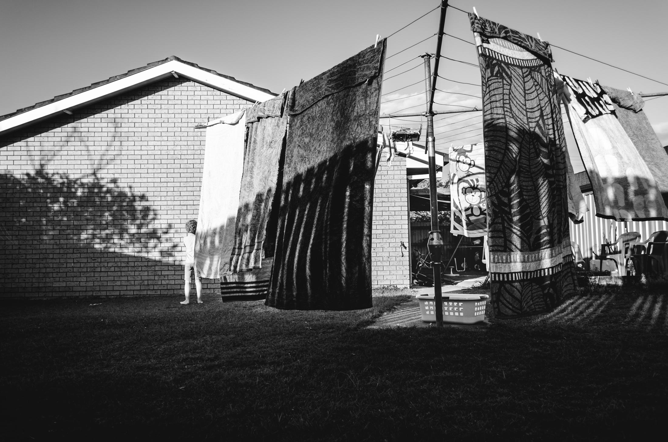 shadows and boy in a suburban Brisbane backyard