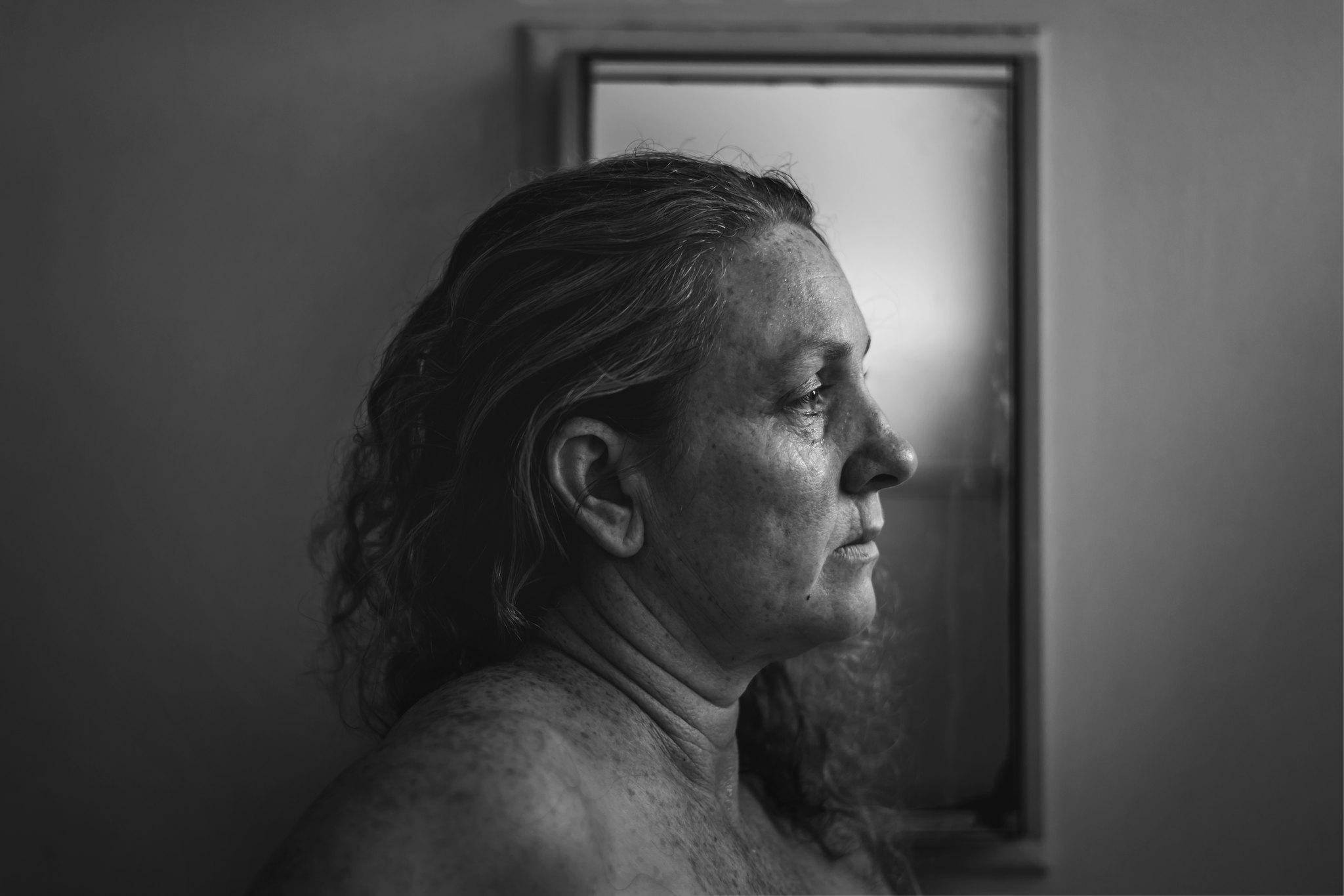 Self portrait in front of mirror by Katy Bindels