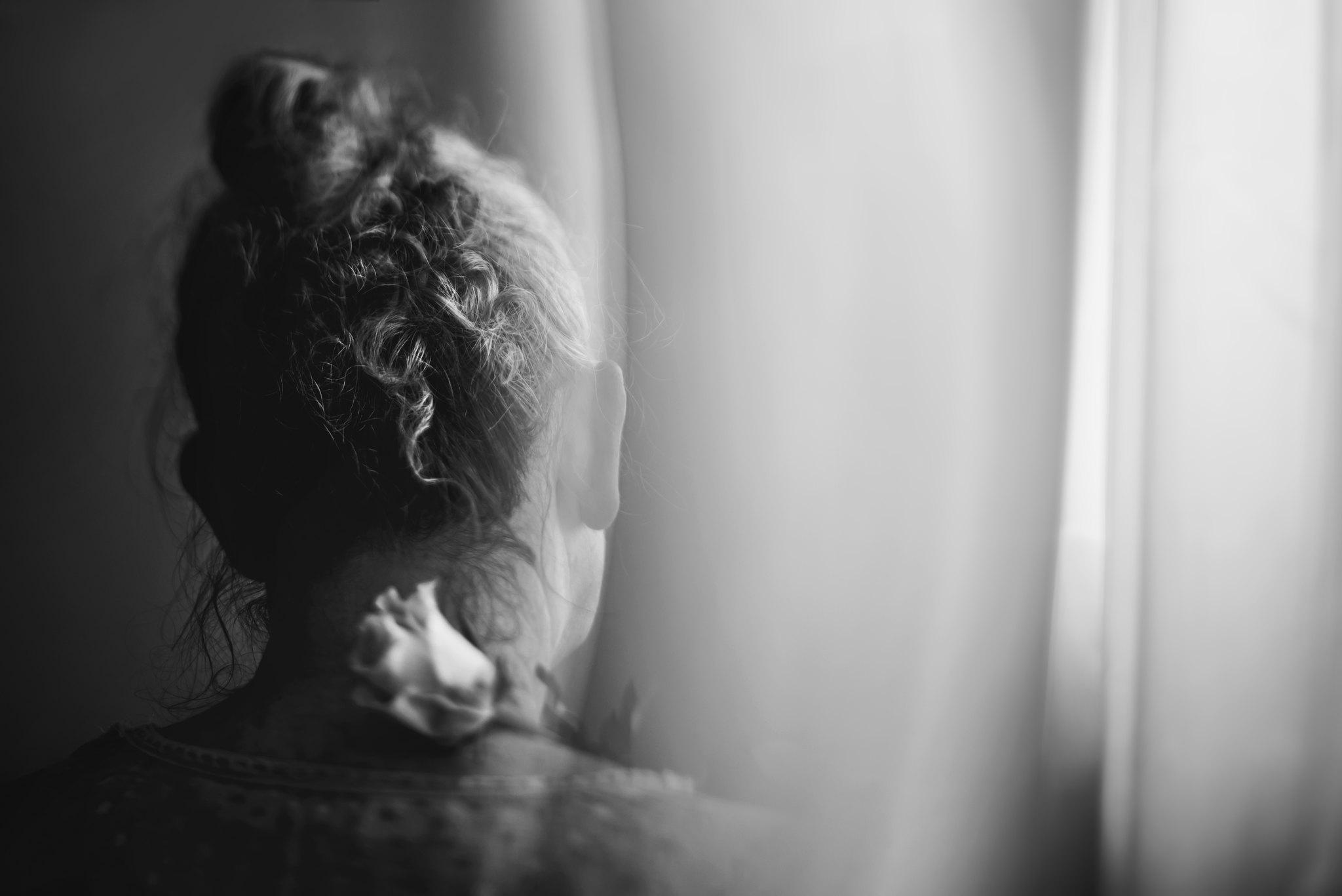 Self portrait with flower 2 by Brisbane photographer Katy Bindels