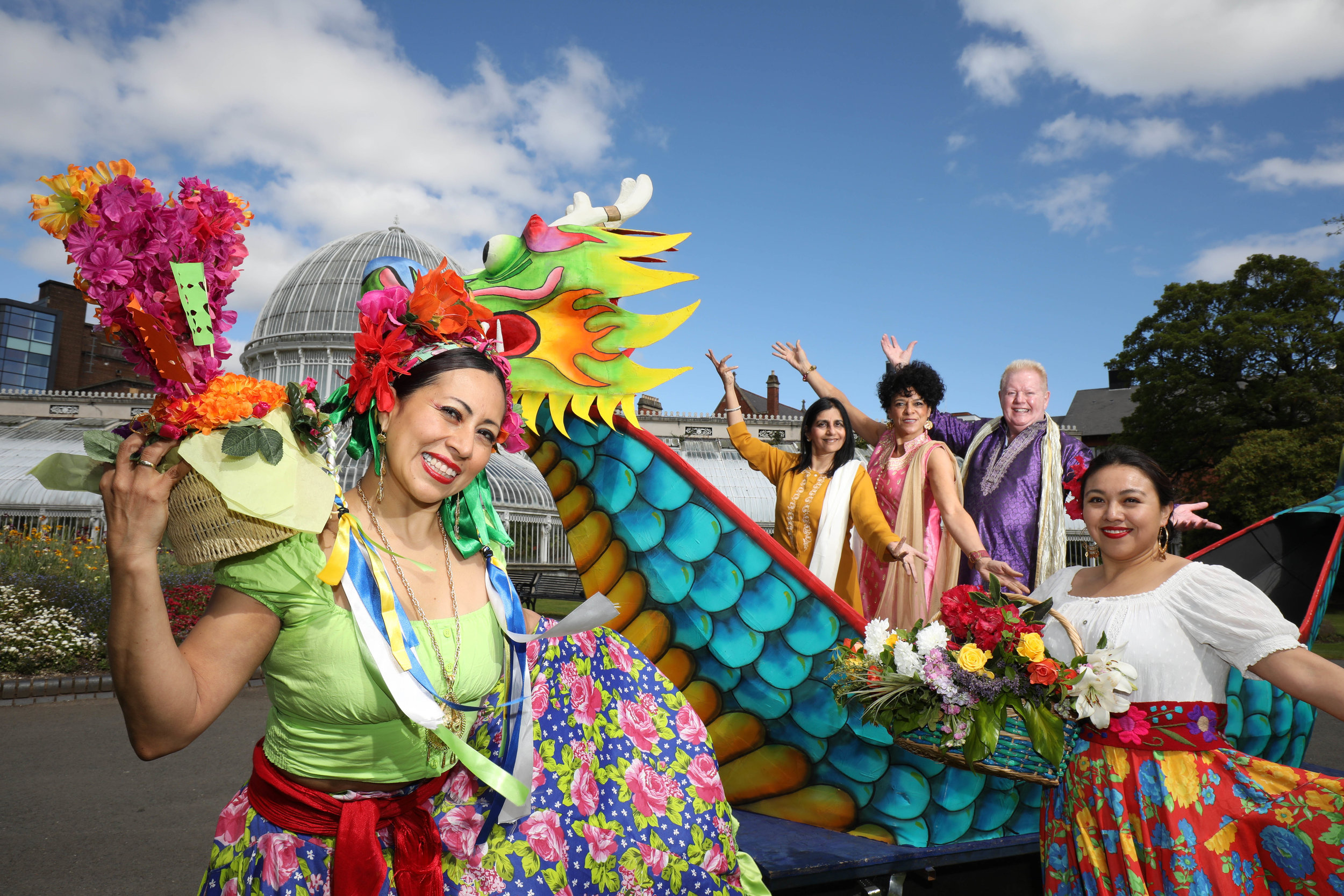 Pictured as the Belfast Mela website goes live online for tickets are: Mexican dancers Mayte Segura and Denise Navarrete with hosts U105's Carolyn Stewart and UTV's Julian Simmons and Nisha Tandon, Executive Director of ArtsEkta and founder of the Belfast Mela in Mela's stunning Chinese Dragon Boat at Botanic Gardens. (©Press Eye/Darren Kidd)