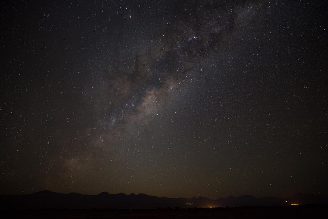 "| 4:02 AM |    ""A still more glorious dawn awaits / not a sunrise, but a galaxy-rise / a morning filled with 400 billion suns / the rising of the milky way.""     - Carl Sagan    I woke up at 3 am, rode a bike alone into the pitch black Atacama Desert, and photographed the center of the Milky Way rise above me. It was something I've always wanted to do, and it was worth it.    I have no words to describe the feelings I felt being underneath all those stars.     (at Atacama Desert, Northern Chile)"