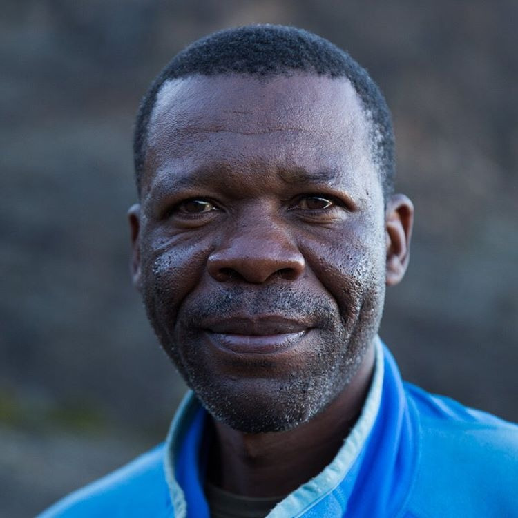 Paul, aka Mr. Pole Pole, is a legend on Mount Kilimanjaro. He's been climbing the mountain for 15 years and has summited more than 200 times. He has spent the night inside some of Kilimanjaro's caves and is very well respected on the mountain. He is sometimes referred to as Babu (Swahili for grandfather) because he has mentored and helped train a lot of the guides.    Kilimanjaro was one of the most challenging things I have ever done, and I wouldn't have been able to make it without people like Mr. Pole Pole.     #makeportraits #bigcatsplayball    (at Mount Kilimanjaro)