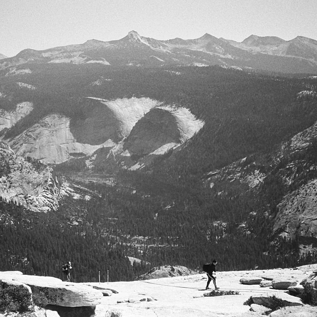 A Yashica B&W film photograph of  me finally reaching the Half Dome summit (8844+ ft elevation), and Yosemite valley 4,737+ ft below me. I don't recommend wearing running shoes for the final vertical granite cable section!! Photo by @mtmorgie #filmisnotdead #bucketlist #neverstopexploring
