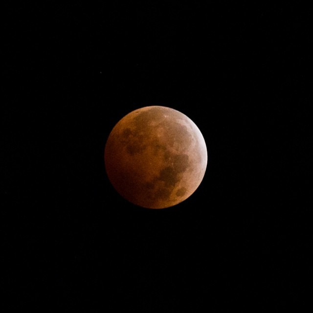 This is the best I could do at 3:56 am this morning without a tripod and on less than an hour of sleep. I'm so glad I woke up to witness and photograph this beauty. It was a peaceful, quiet, serene, and unforgettable moment that made me feel small #bloodmoon #lunareclipse #totallunareclipse #seeingred #totaleclipseoftheheart  (at Dana Point, California)