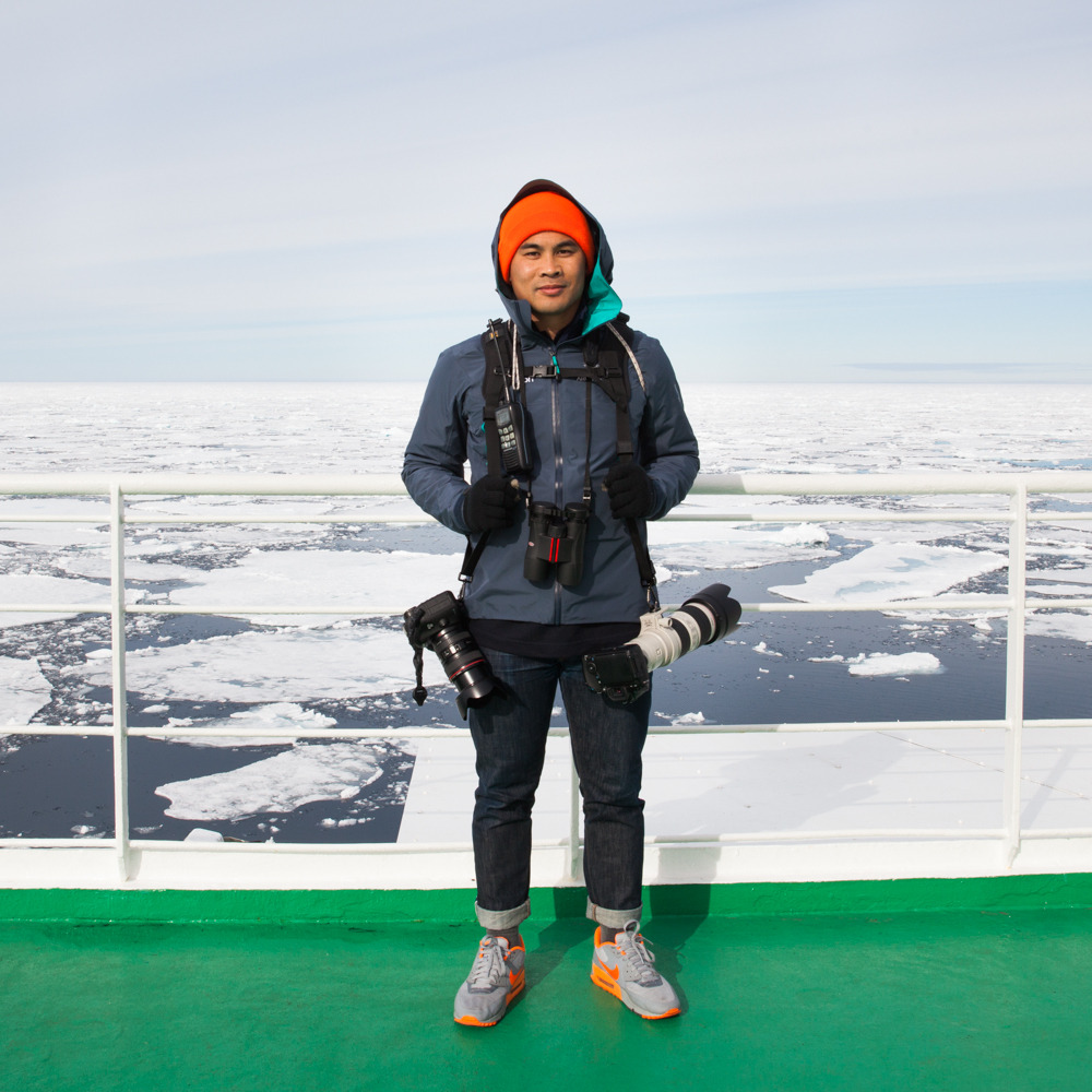 """Arctic Self Portrait     An Arctic self portrait taken less than 600 miles from the North Pole, while we search for polar bears near the pack ice.  Thanks for joining me on this wild adventure. It's difficult to describe my experience in the Arctic as a photographer in residence, but I definitely have a greater appreciation for our planet. I've learned a tremendous amount and had the wonderful opportunity to be part of a gracious, knowledgable, and talented expedition team. I'm excited to be back on the ship headed to Antarctica next February, which would mark my 7th and final continent. Antarctica has actually been on my bucket list ever since I did a school report on it in third grade.       I will leave you with this quote by Paul Nicklen, a National Geographic photographer and biologist, that truly resonated with me:       """"I want to bring back images of this remote, raw, unforgiving, beautiful, and yet extremely fragile world to you. I want you to care about these regions as much as I do, and I hope to inspire you to help avert the warming trend that is changing them quickly and irreversibly.""""        Live Adventurously,  Reuben"""