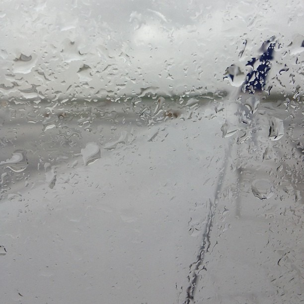 Headed to sunny beaches. F the rain (at LaGuardia Airport (LGA))