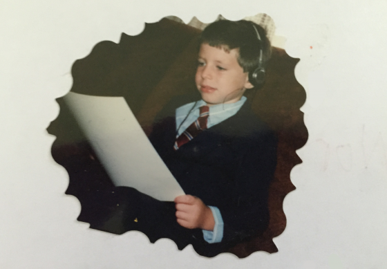 Little boy studies drumming music