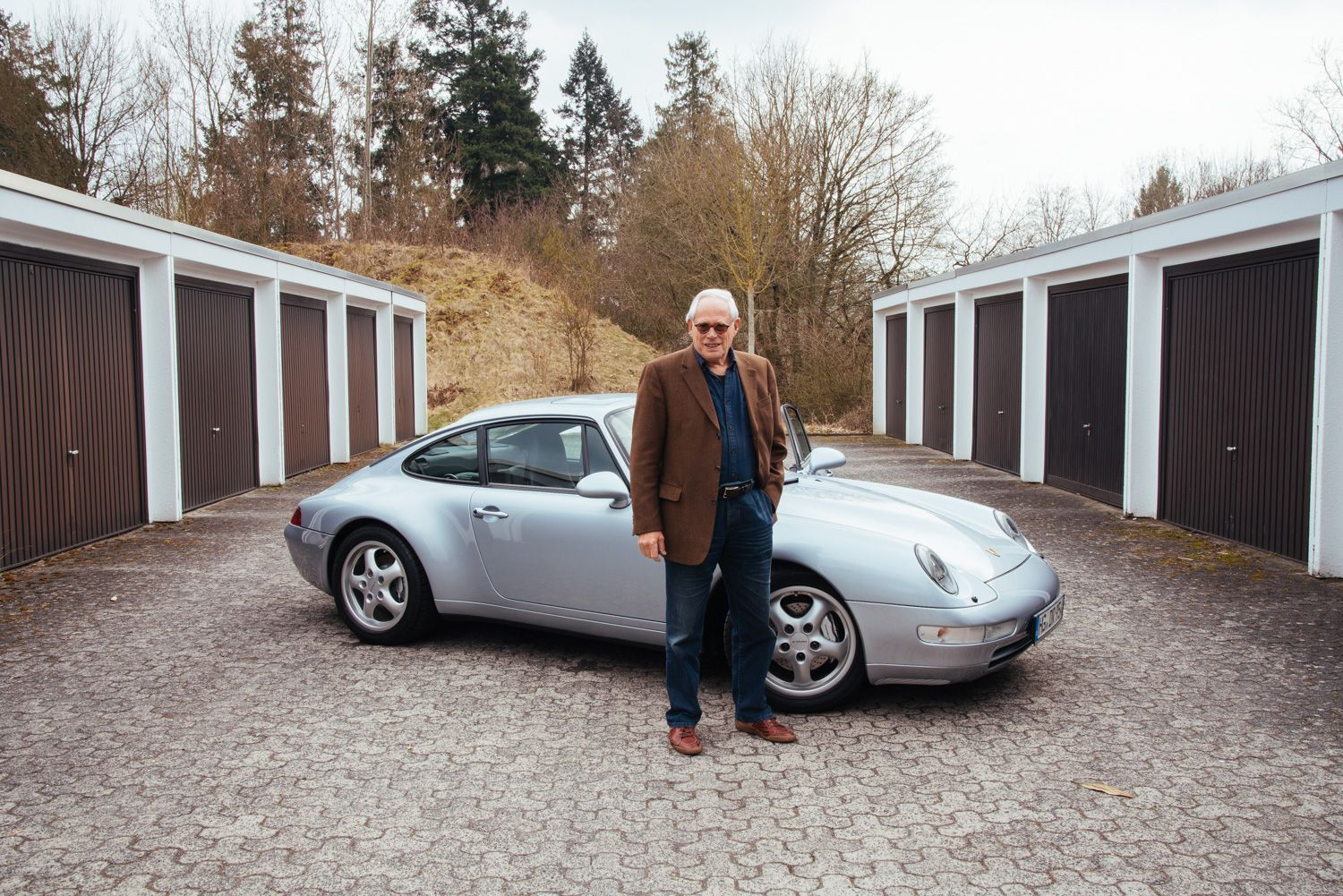 Dieter Rams and his silver Porsche 993, arguably the greatest sportscar ever.