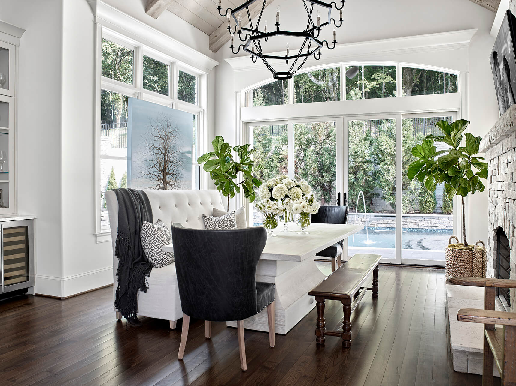 Dining area with dark wood floors with white and gray furniture - Rustic Contemporary Bureau Interior Design Nashville TN