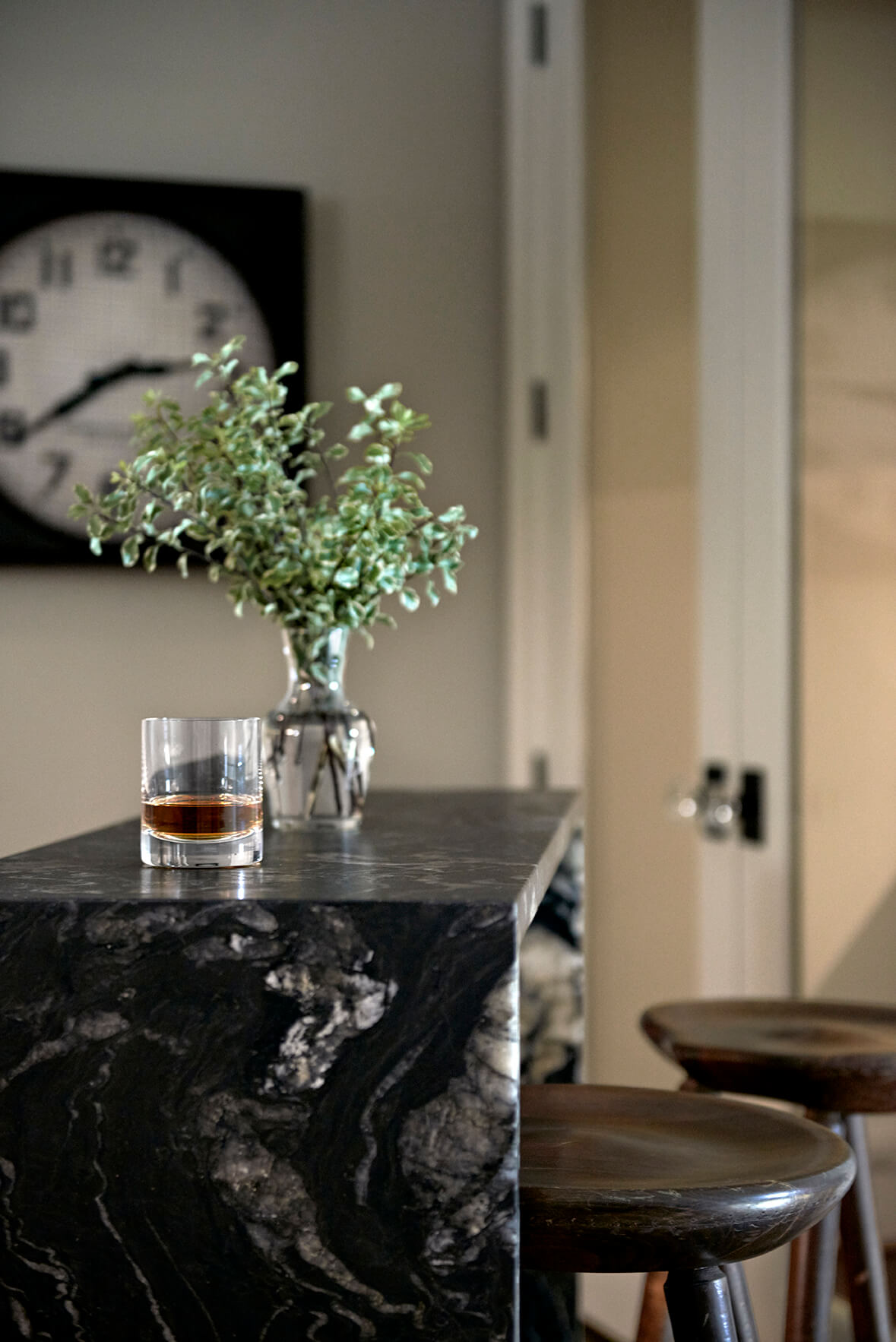 Black and gray marble bar with a small plant and rock glass on top - Rustic Contemporary Bureau Interior Design Nashville TN