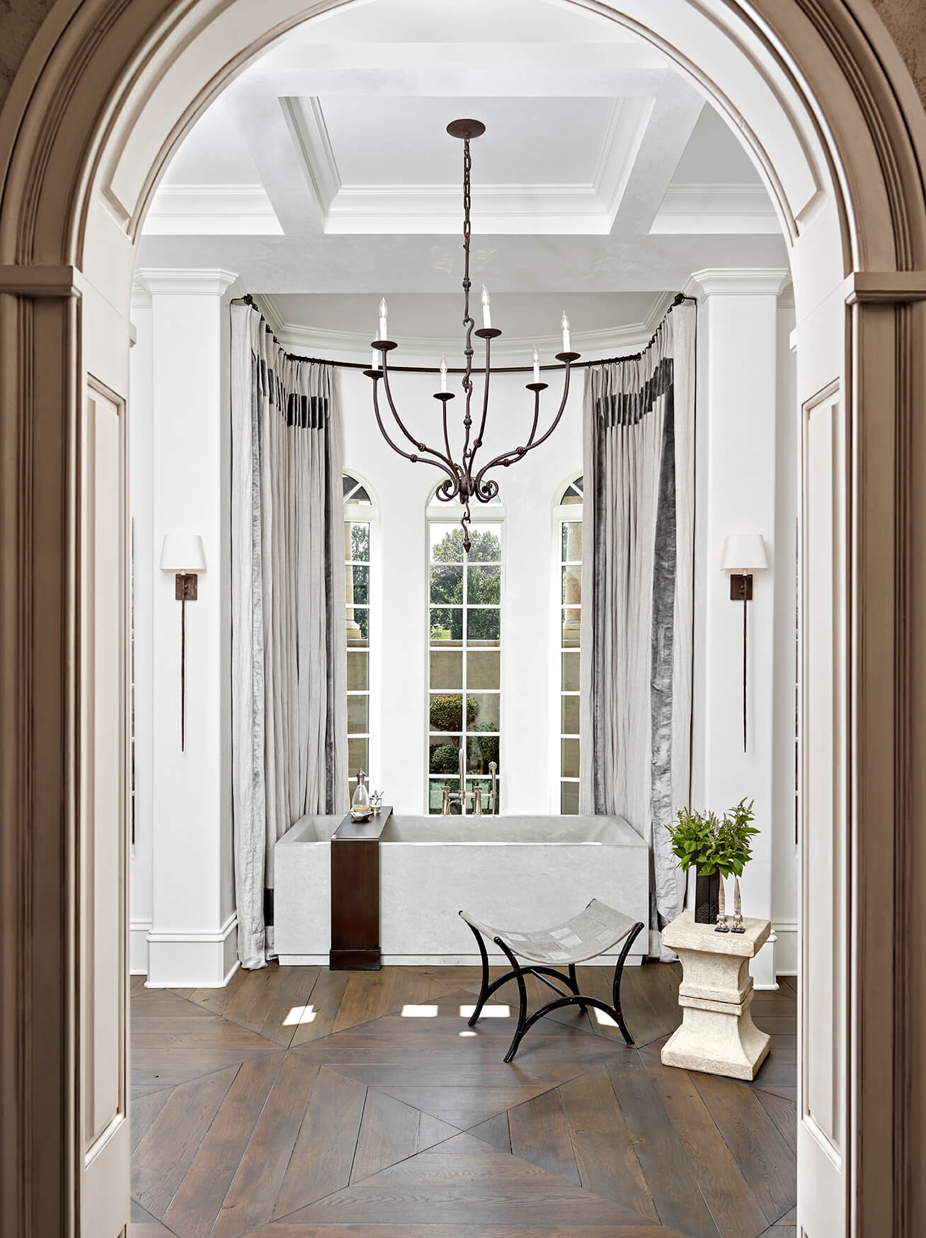 archway-to-luxury-bathroom-dark-wood-floors-formal-transitional-bureau-interior-design-nashville-tn.jpg