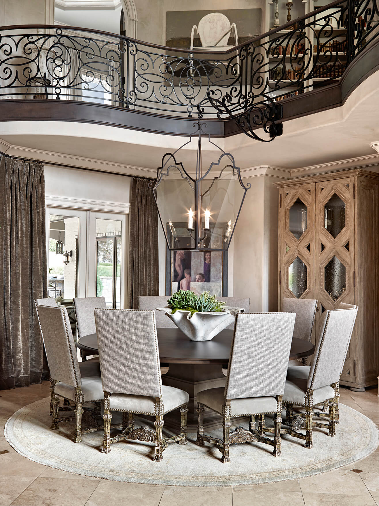 round-formal-dining-room-table-below-balcony-formal-transitional-bureau-interior-design-nashville-tn.jpg