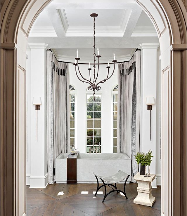 Throwing it back this Thursday to our first project in Nashville—a full renovation of a formal Mediterranean manse. We retained the architectural bones, but infused modern treatments and textures to give this space a transitional feel. Belgian bluestone, French white oak, Calcatta Gold Oro, Venetian plaster, wrought iron, and sumptuous textiles combine to make a dramatic statement without the appearance of much fuss. || 📸: @photourworld || #interiordesign #masterbathroom #bathroom #bathroomdesign #modernmeetsmediterranean #serene #respite #tbt