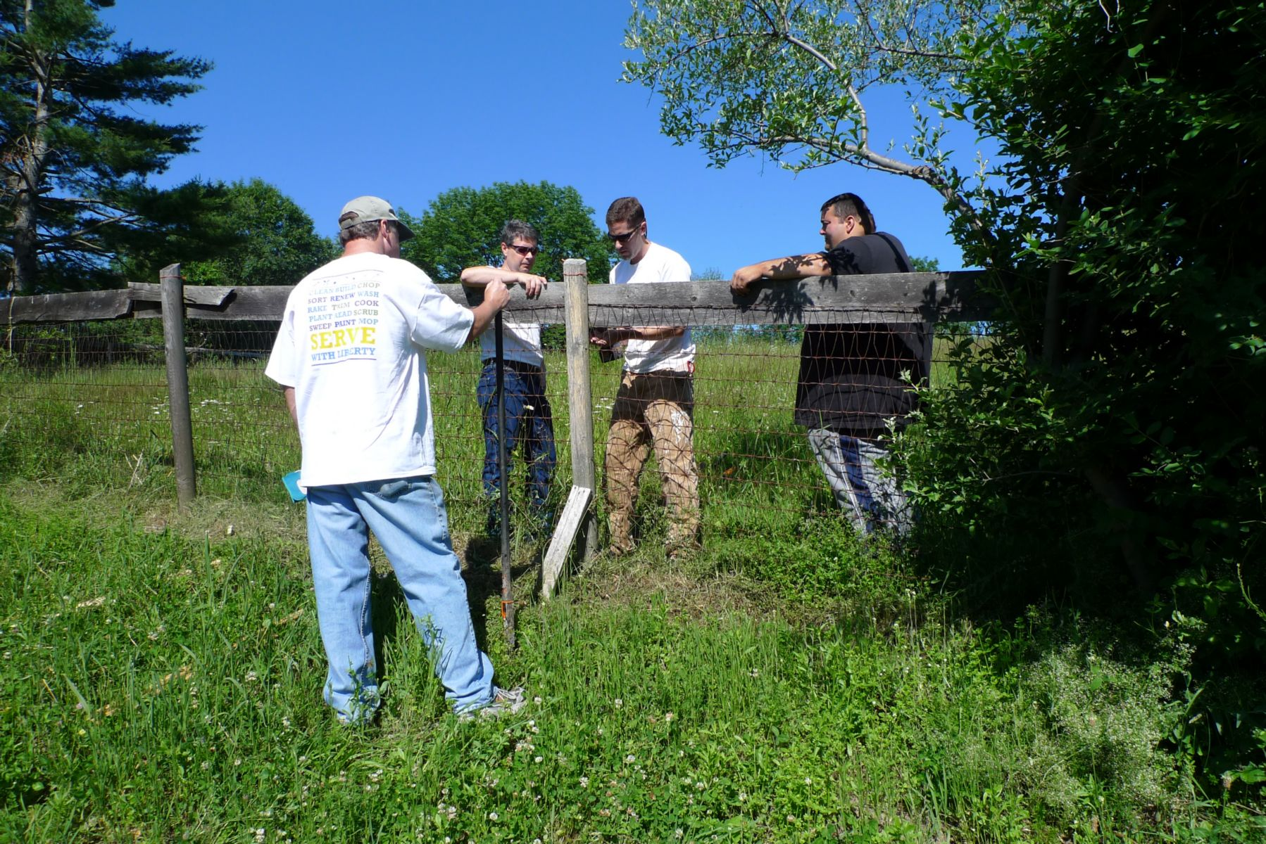 Corporate, youth, and community services organizations helping withfence repairs.