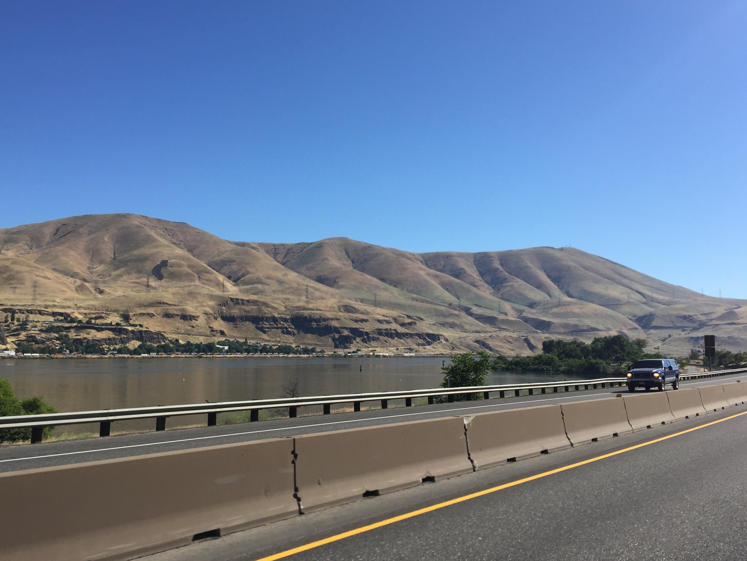 Heading east along I-84 at the former site of Celilo Falls. It is an unanswerable question now. The wildness of this river sits submerged beneath a series of lakes that were once the Columbia River. Here in the Northwest, however, we are not confronted with the ugly specter of coal fired energy generation except by the trains that haul the material to the coast from the Wyoming coal fields. The dams on the Columbia now serve as a valuable waterway upon which goods and raw materials move back and forth. We flip on the lights any time we need it. It is so ubiquitous, it is easy to forget about where it comes from and who the winners and losers are in that equation. Celilo Falls probably are not coming back in the foreseeable future. But I feel it is important to reflect that these actions amounted to a systematic ethnic cleansing brought about by a rapidly expanding nation with a dark history of similar actions towards indigenous peoples.