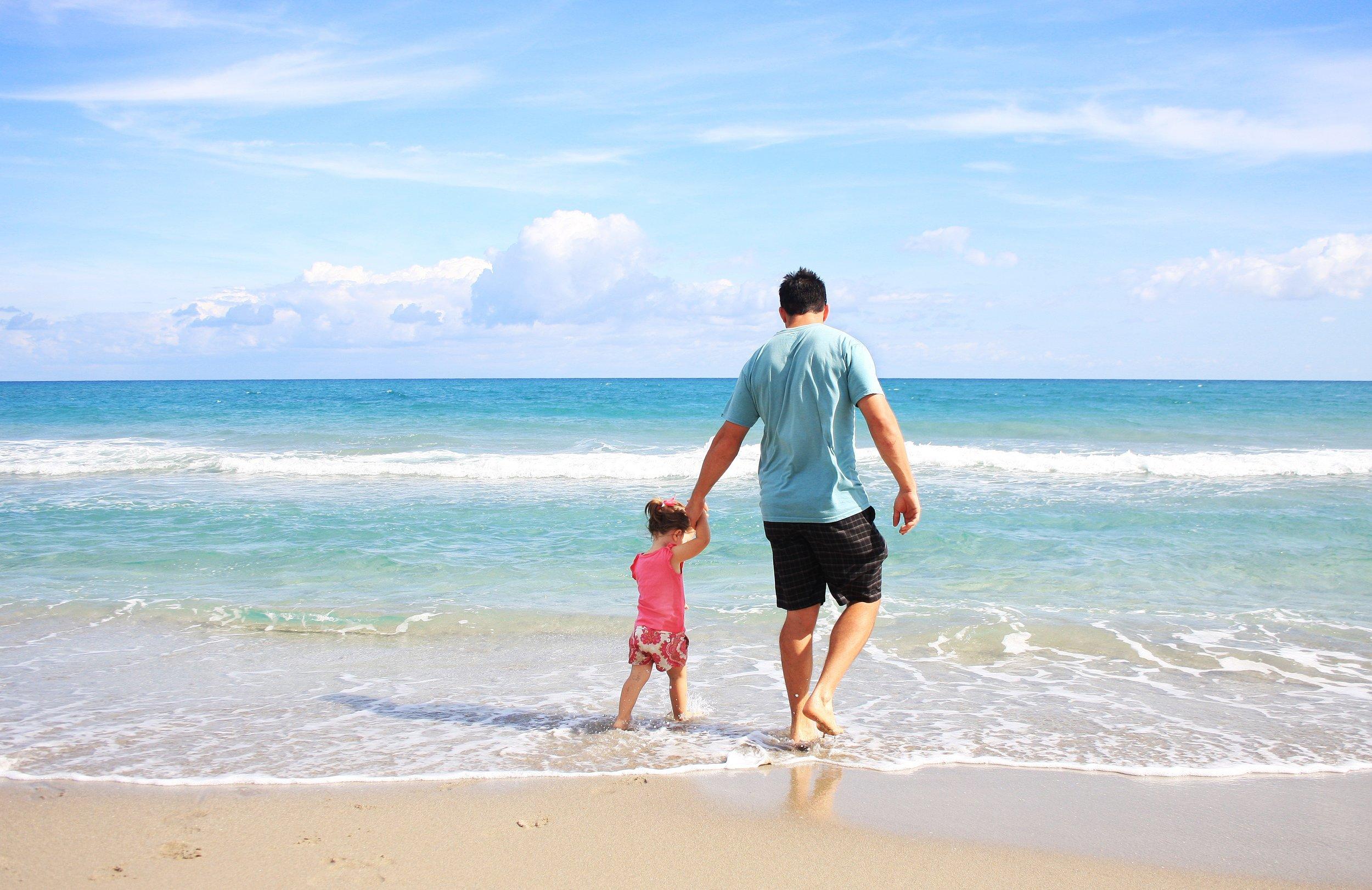 father-daughter-beach-sea-38302.jpeg