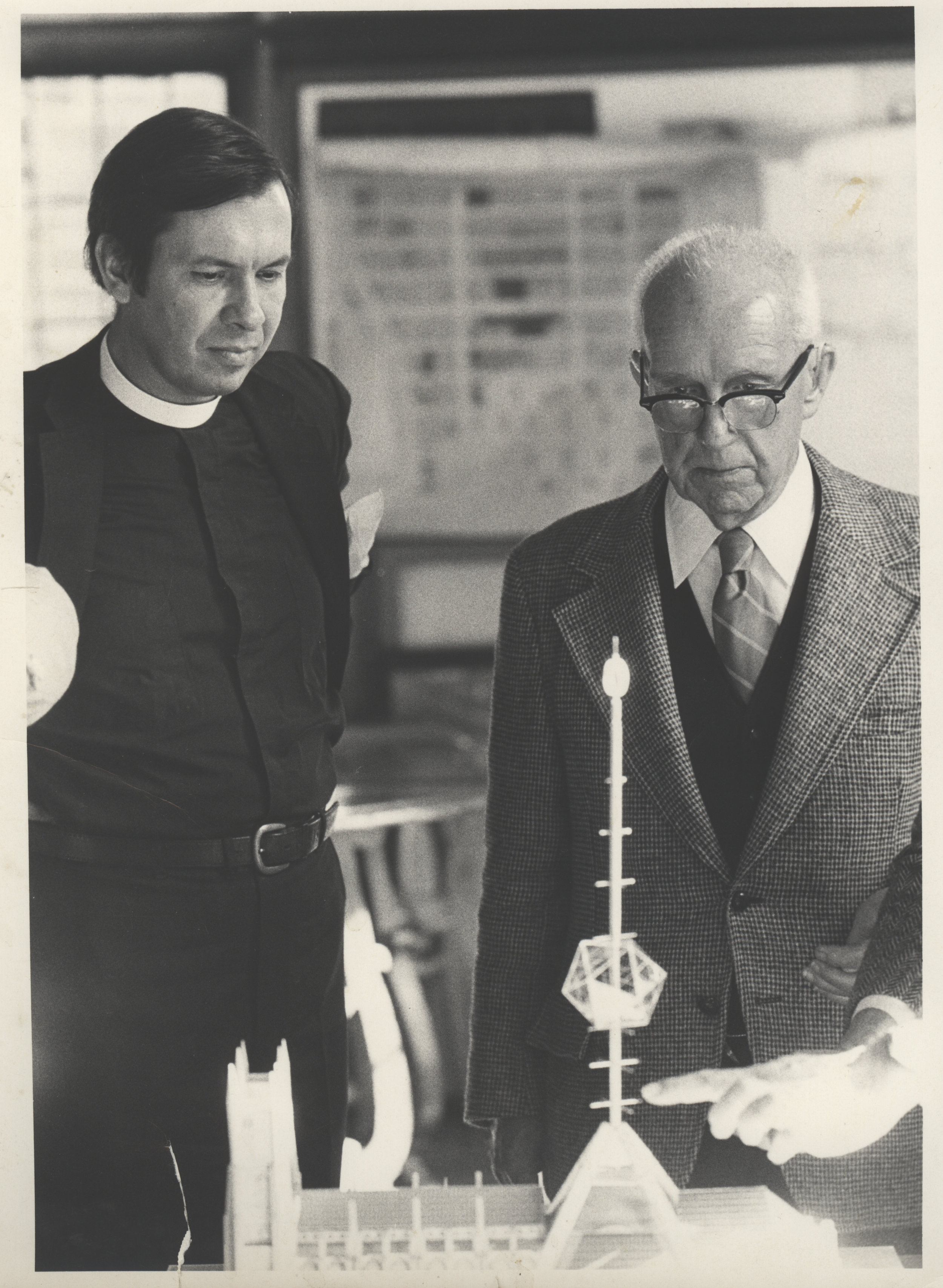 1980s: At the same time Dean Morton solicited designs to complete the whole cathedral. Here Buckminster Fuller stands with Morton showing a 600 foot spire piercing a geodesic dome. Credit:  Episcopal Diocese of New York Archives