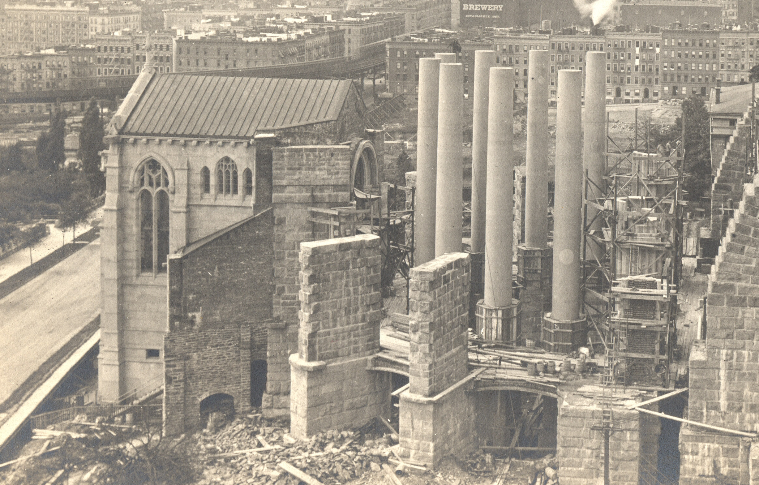 1905: Having spent most of their first decade building a gigantic foundation, thirteen years into construction the cathedral had only just erected the eight granite columns for the choir. They would cost $25,000 (today, $761,000) each. Credit: Episcopal Dioceses Archive of New York