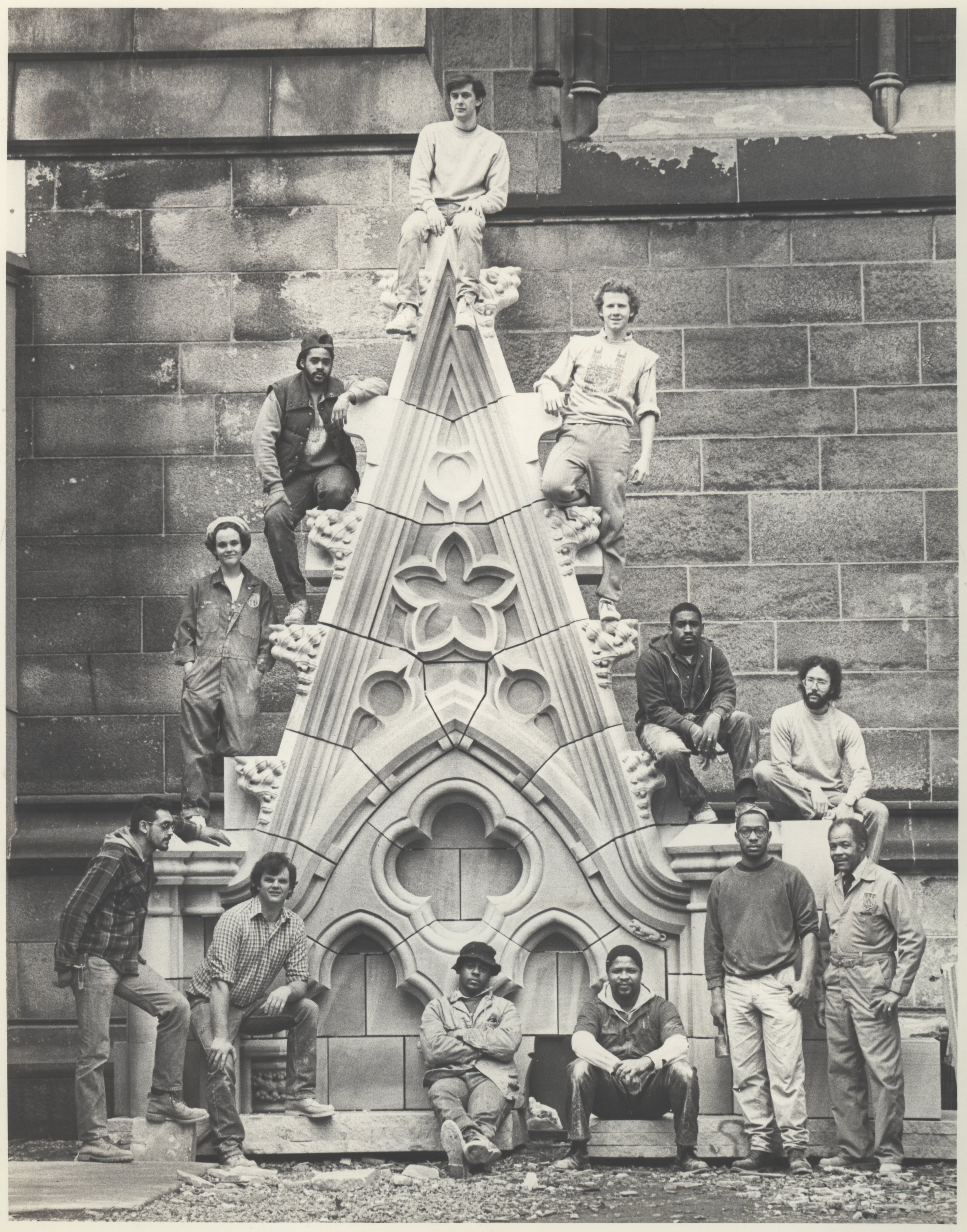 1980s: Group portrait of the stone masons. There was something modular about this approach to construction: each stone represented a discrete finish line and accomplishment. Credit: Episcopal Diocese of New York Archives