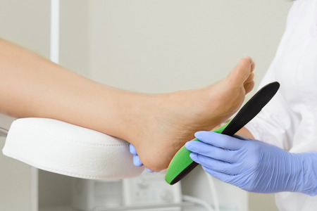 89289736_S_foot_arch_person_orthotic_doctor_custom.jpg