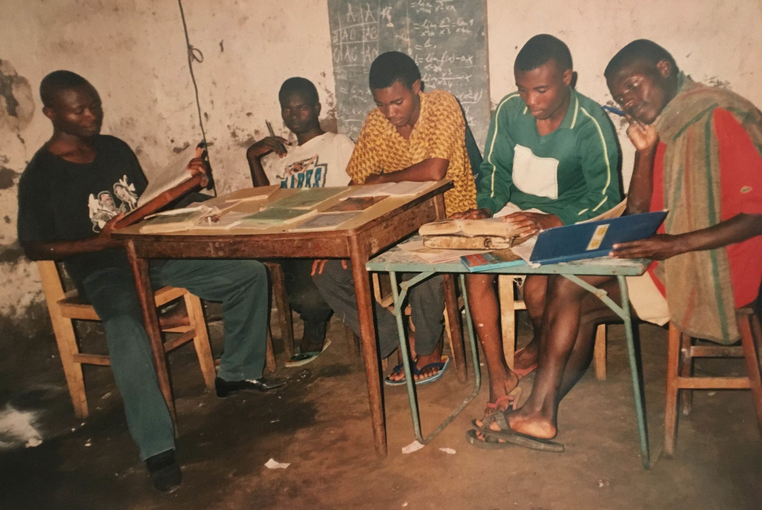 Bolingo studying with friends in the DRC.