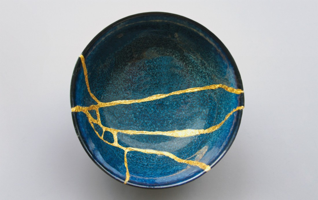 Kintsugi:the Japanese art of repairing broken ceramics with laquer mixed with gold.