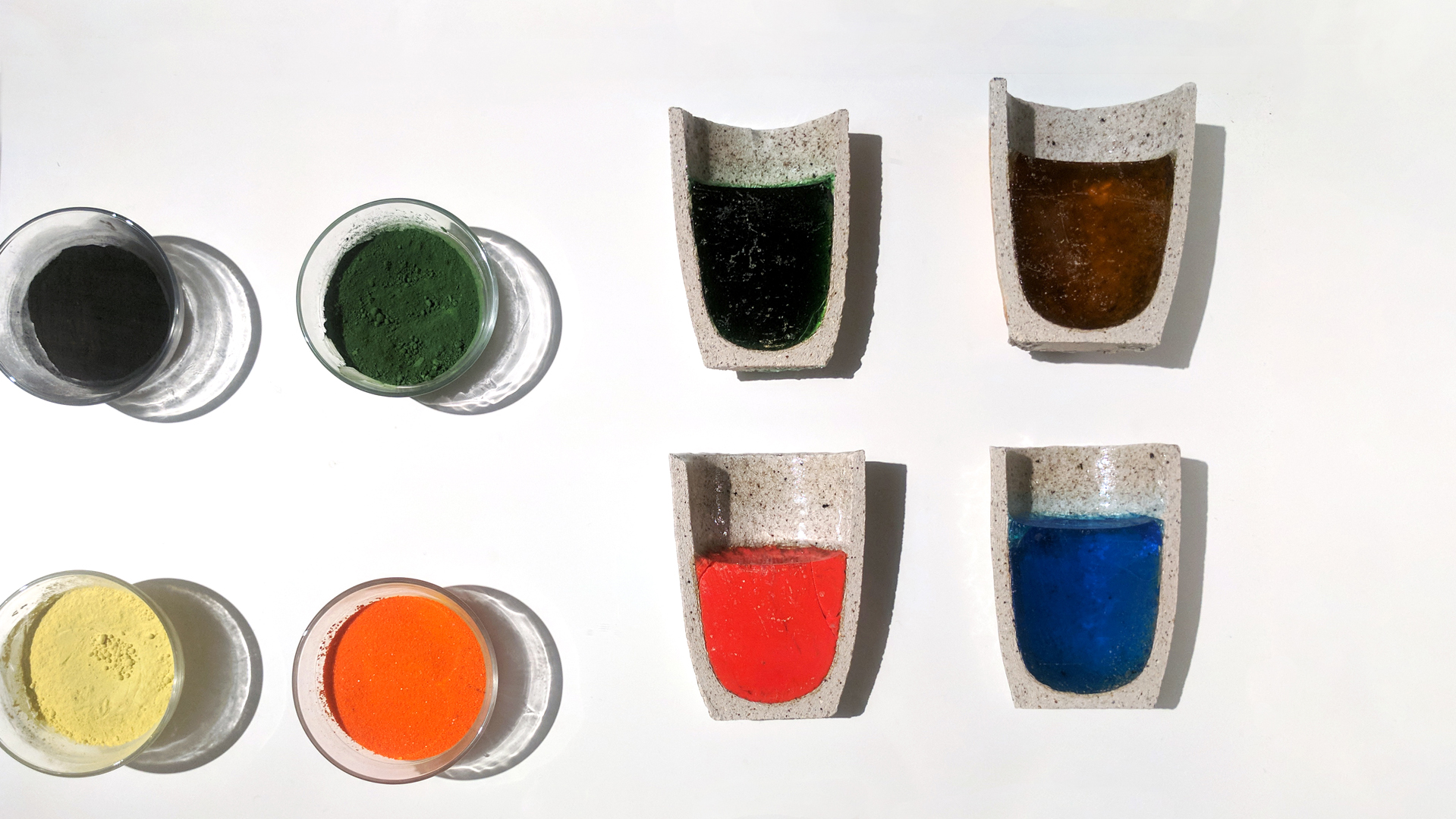 Various metal oxides (left) are dissolved into the glass to change it's color. The cobalt blue on the bottom right is actually made with cobalt oxide! Ceramic pots called crucibles are used to hold the the molten glass mixture. The crucibles on the right have been cooled down and cut in half.