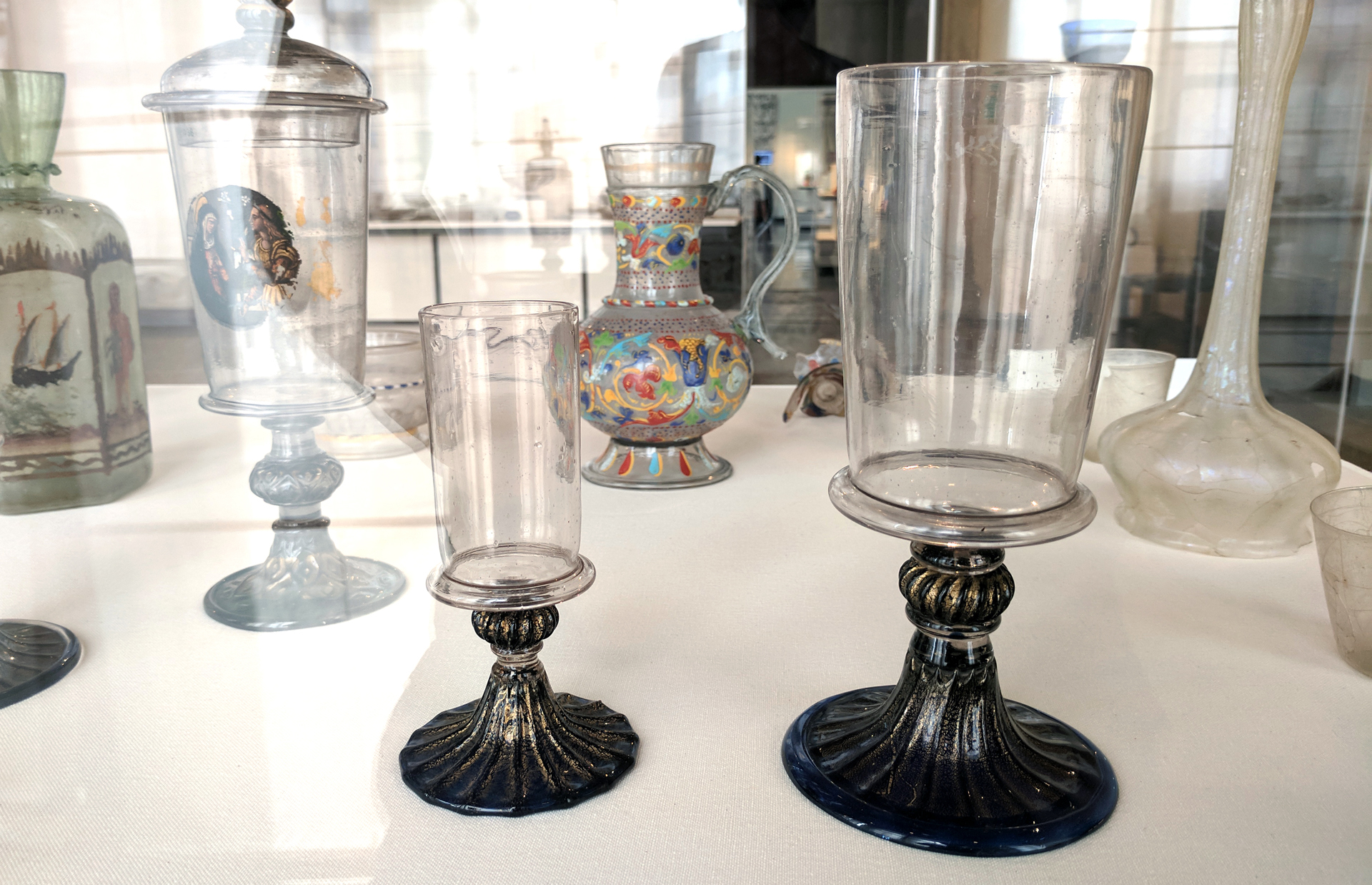 The goblet lid (top left) and the bottoms of the cup sections of the two goblets in the front of the picture are 16th century examples of the technique that lead to the first  Saturn Glass  prototype