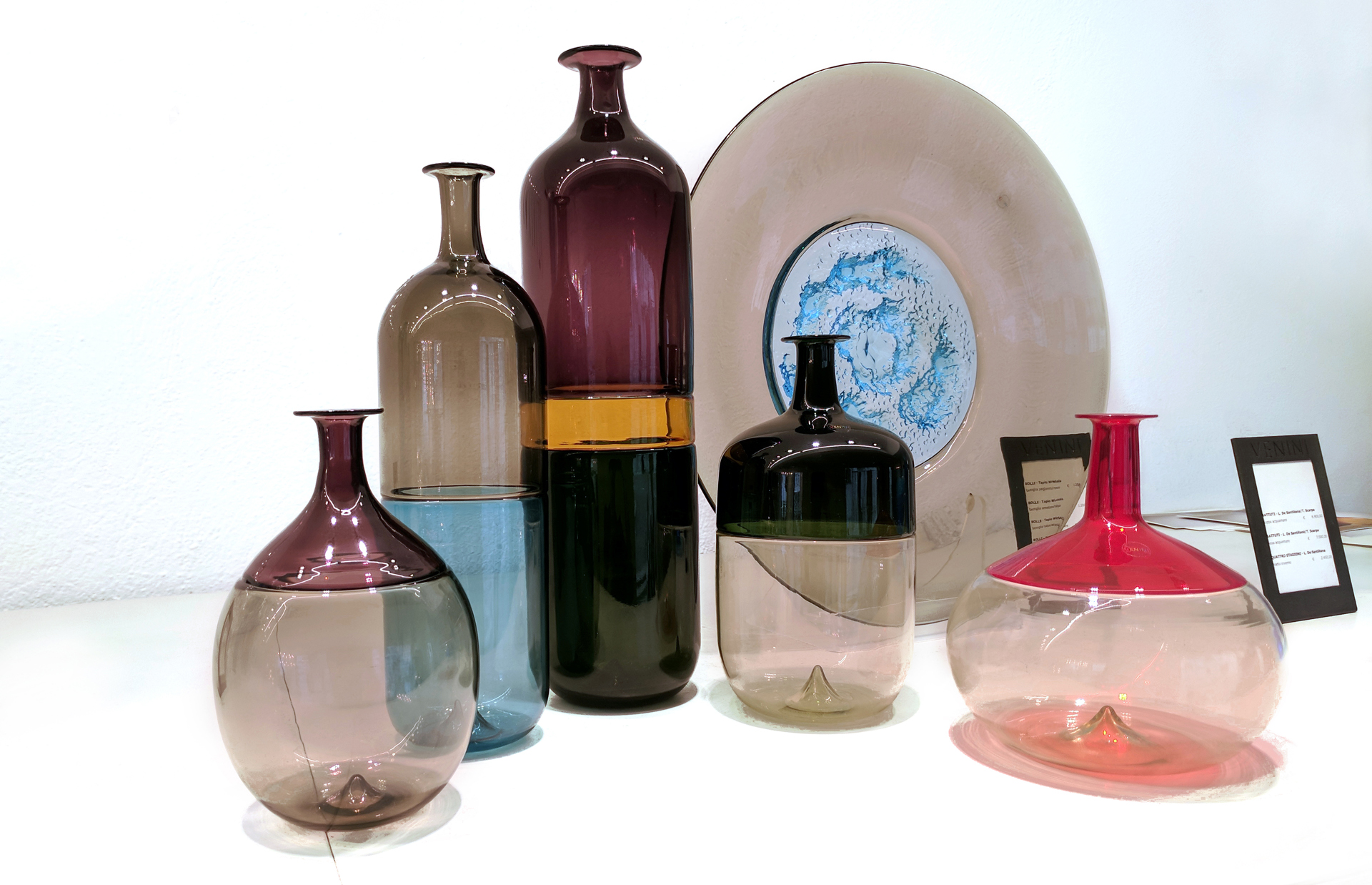 Classic pieces from  Venini , a Murano glass studio that makes it's pieces by collaborating with designers! The collection of bottles  ( Bolle , 1966)  and the plate  ( Piatto Di Tapio , 1970)  are designed by Finnish designer Tapio Wirkkala. We are huge fans of Tapio!