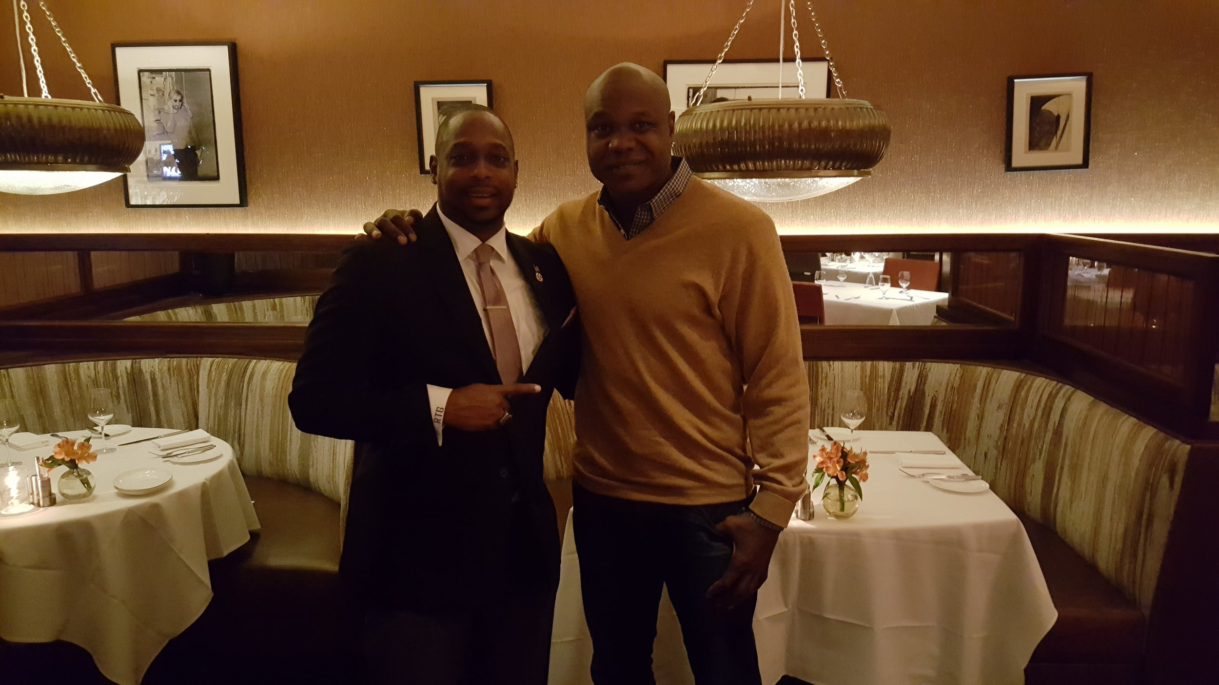Robert T. Green discussing business with former NFL All Pro Keith Bullock