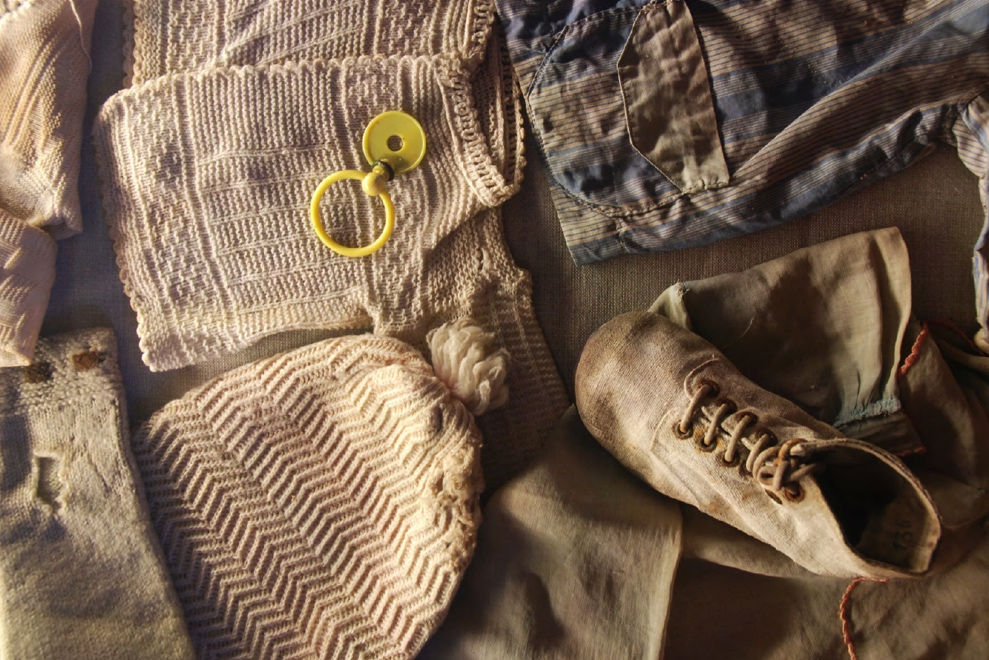 Conservation of textiles. - The authentic remains of the camp include original brick and wooden barracks, crematoria, towers, archival materials, photographs, suitcases, prayer garments, glasses, pots and pans, shoes, works of art, and even Cyklone B cans.