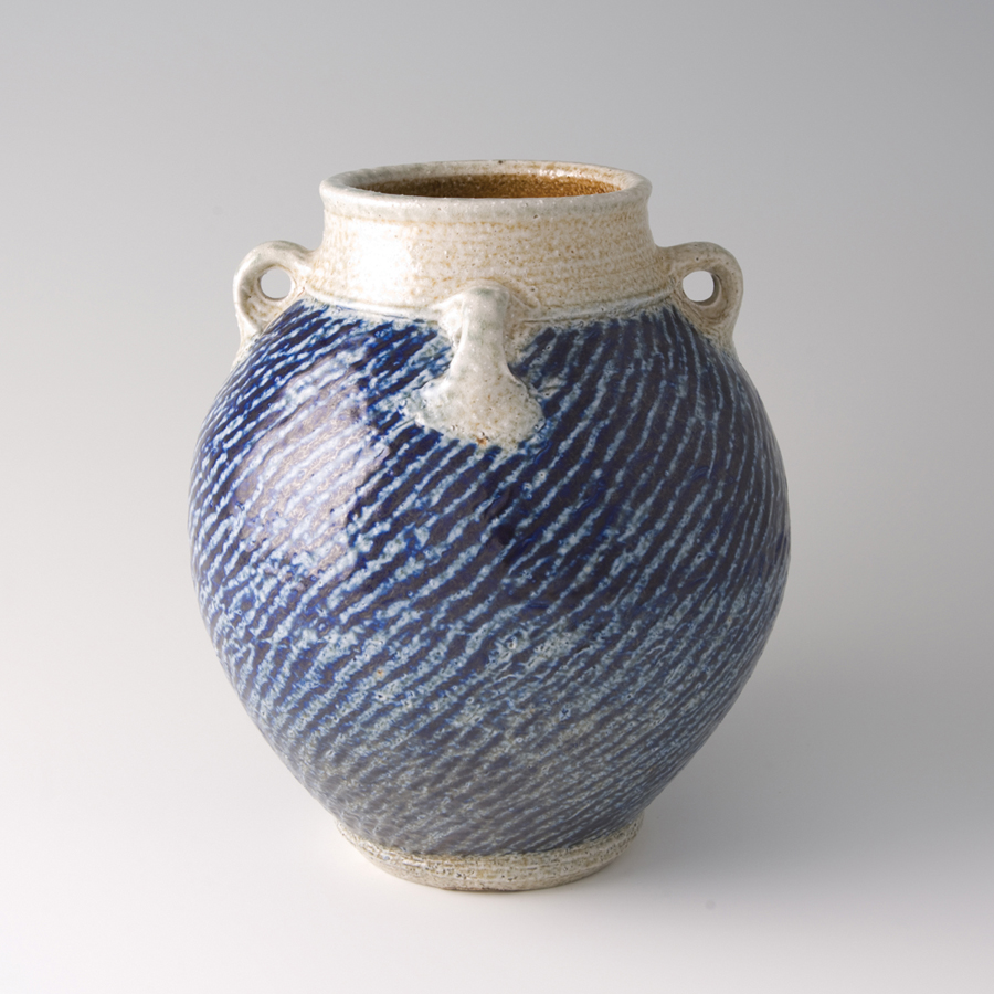"Tatsuzo Shimaoka  Jar with lugs, rope and slip inlay with cobalt blue salt glaze  Stoneware 8 x 7 x 7"" 71 with wooden box"