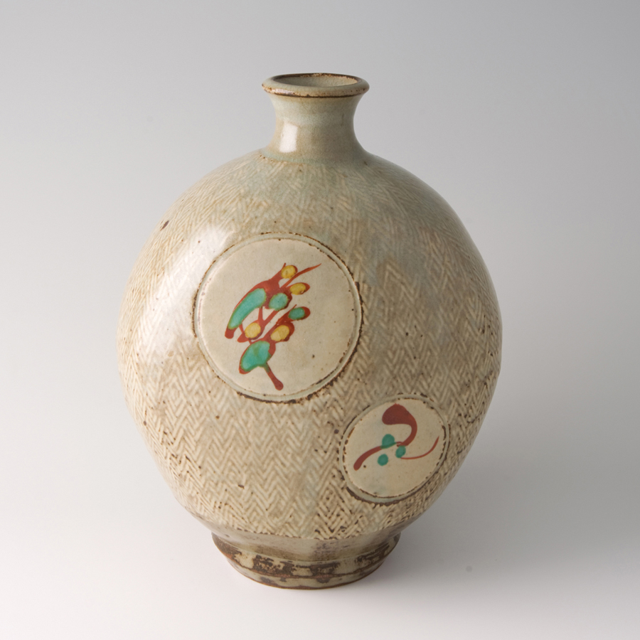 "Tatsuzo Shimaoka  Bottle, rope and slip inlay with wax resist overglaze enamel decoration  Stoneware 9.25 x 7.5 x 7.5"" 152 with wooden box"