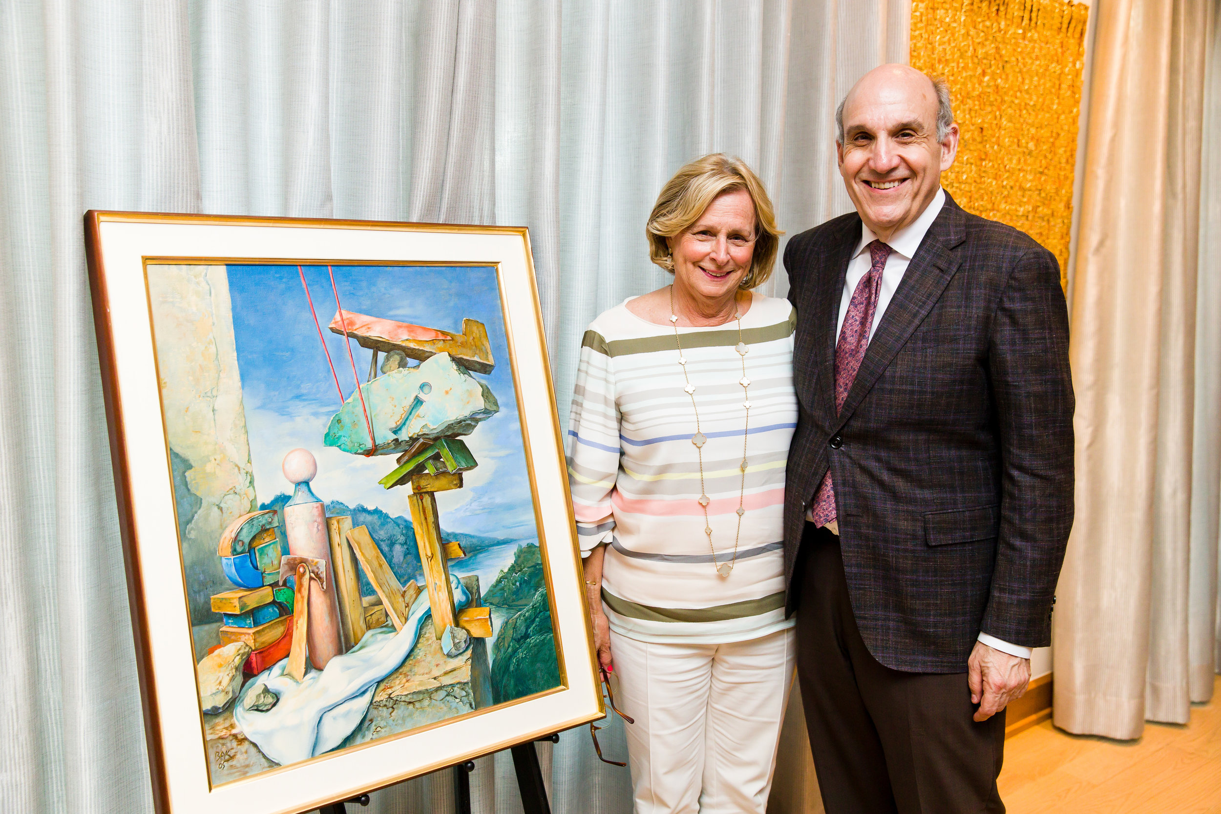Joy and HMH Board Chair Benjamin Warren with Bak painting at the Private Reception with Bak for HMH Art Circle Members, 17 June 2019; Photographed by Daniel Ortiz