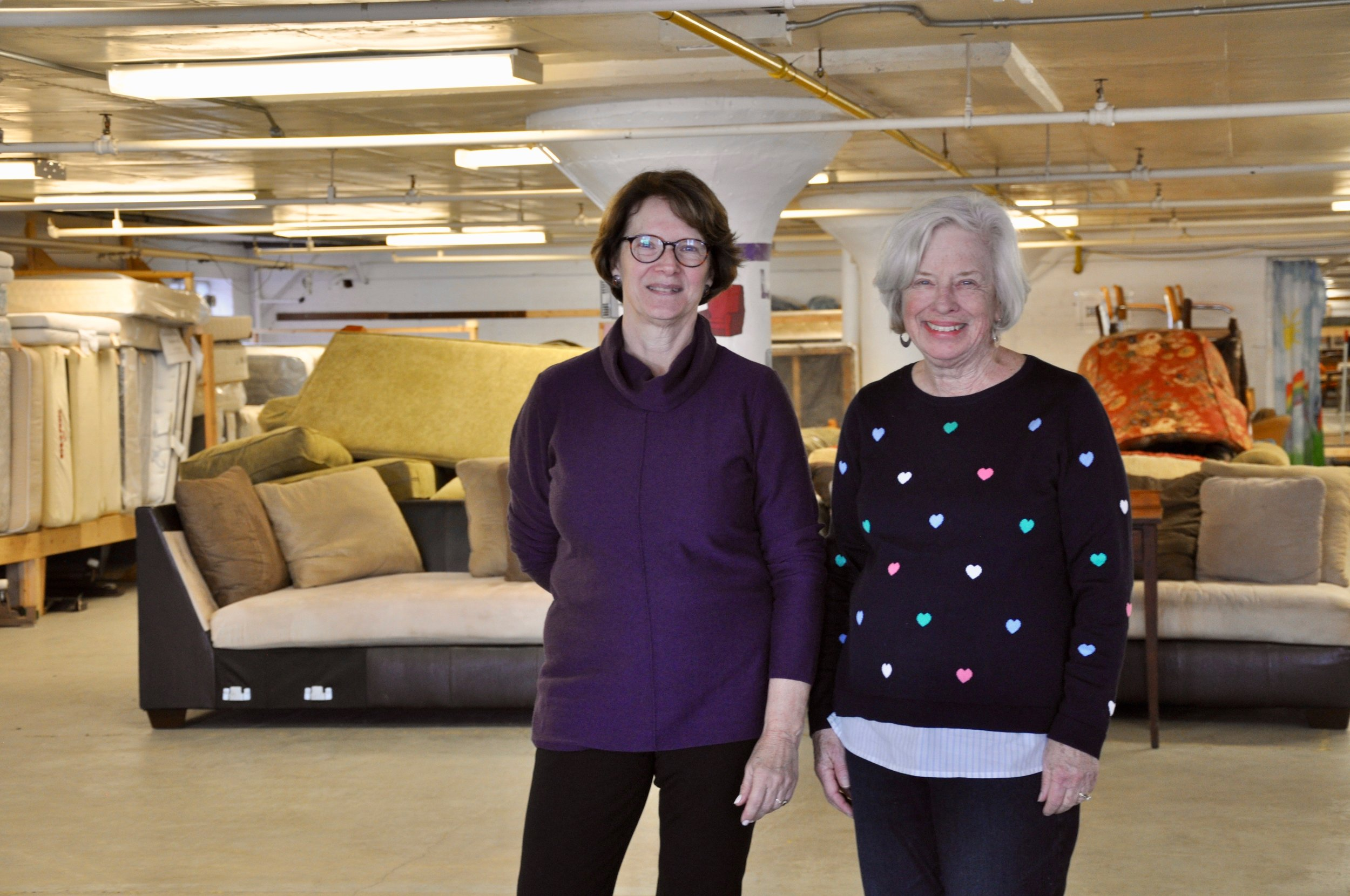 Volunteer Coordinator Laura Stanton and Founding Member Barbara Yates stand committed to helping families recover from homelessness, breaking down stereotypes and giving clients a warm, respectful experience at New Life's distribution center.