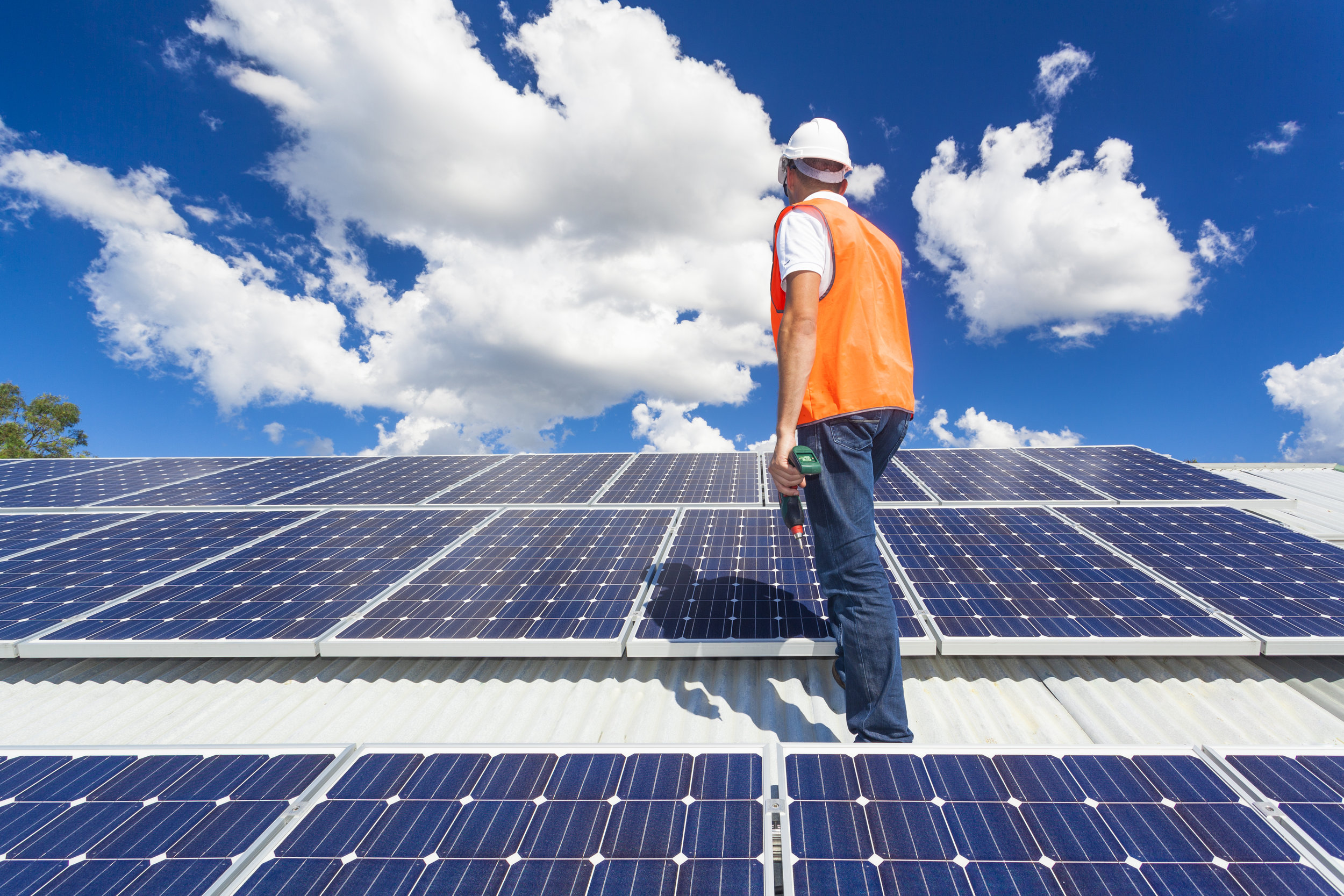 bigstock-Solar-Panels-With-Technician-69571384.jpg