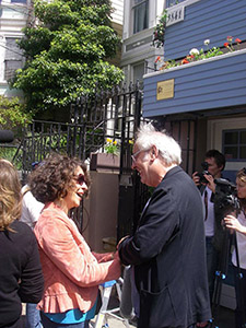 Lua meets the legendary Maxime Le Forestier for the first time, at the blue house, in San Francisco's Castro District.