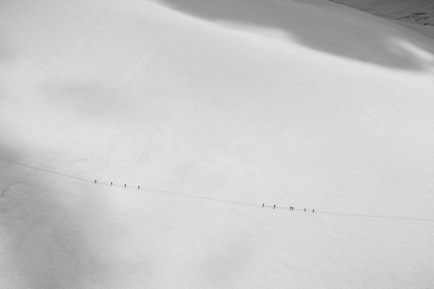 Two groups walking across the Col Du Midi.  Canon 6d, 24-70mm F4L IS @ 70mm, 1/500s, f/11, ISO 100.