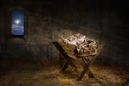 63774352-jesus-resting-on-a-manger-while-light-from-the-star-filters-into-the-room.jpg